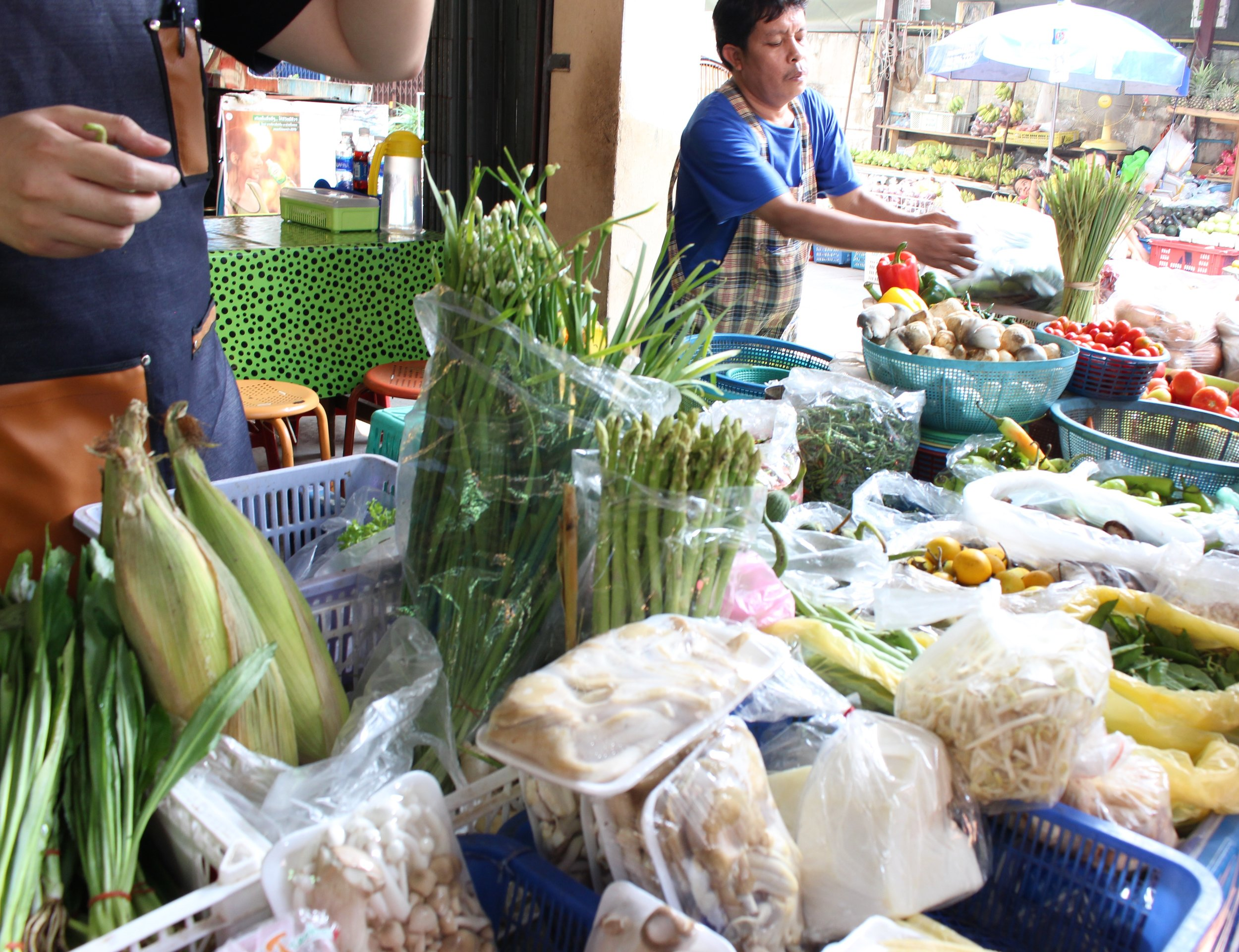 Visiting the market to learn about the different produce