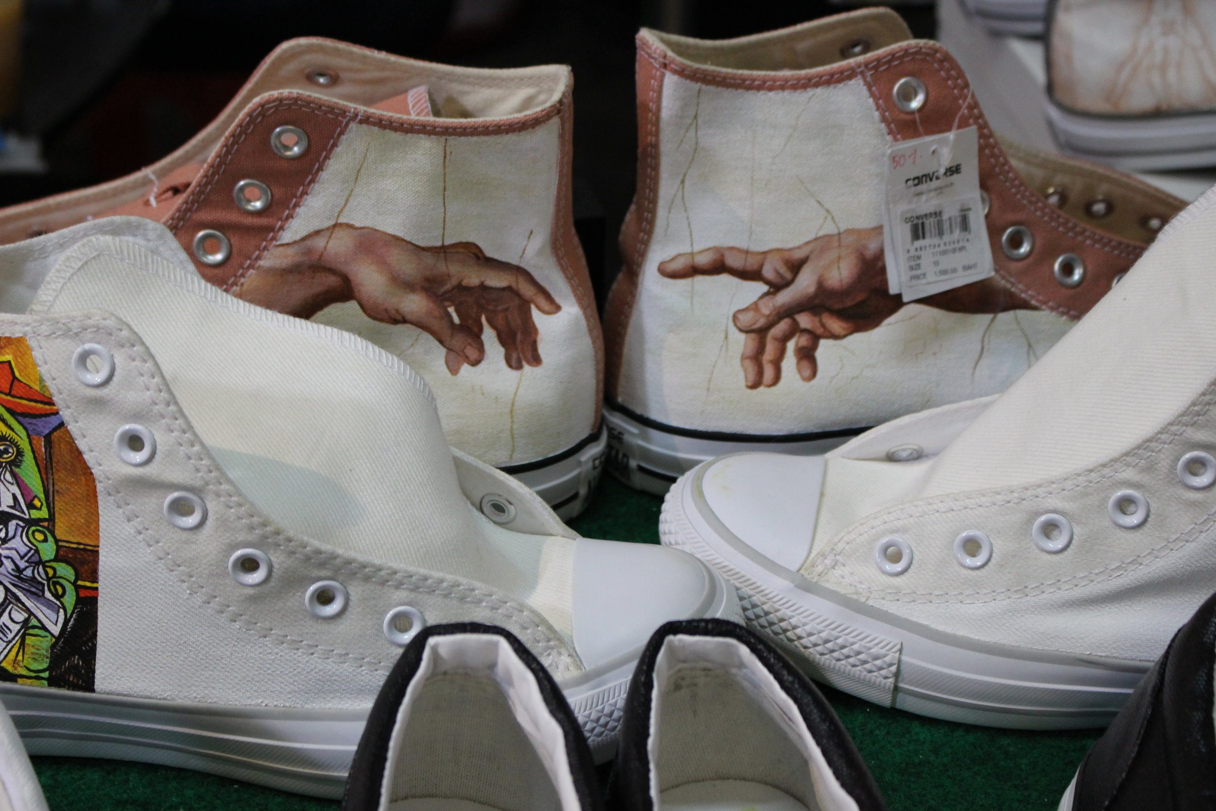 Michelangelo's The Creation of Adam on a pair of Converse high tops