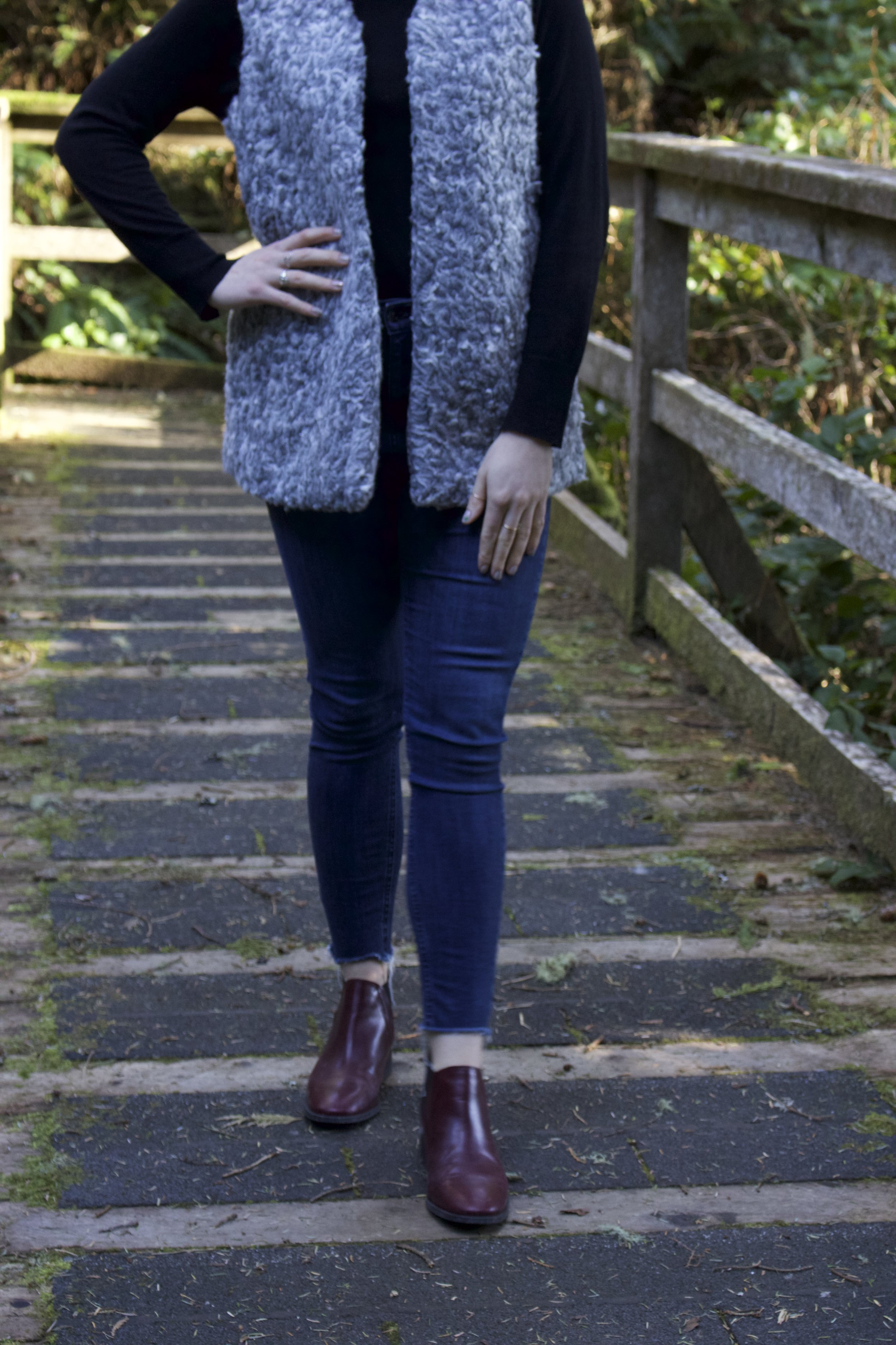 MARK    fuzzy vest,    Zara    Black Sweater,    Topshop    Dark Jeans,    Topshop    Chelsea Booties