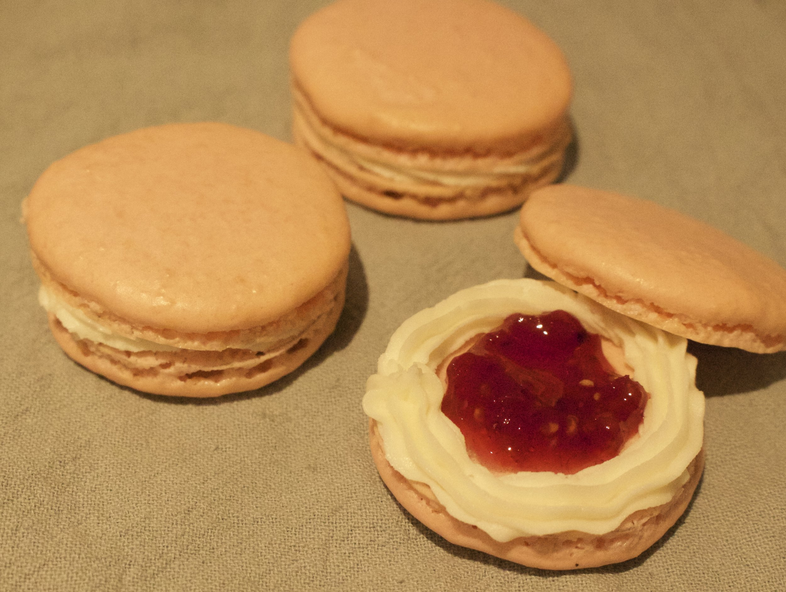 Sandwiched with vanilla buttercream and raspberry jam