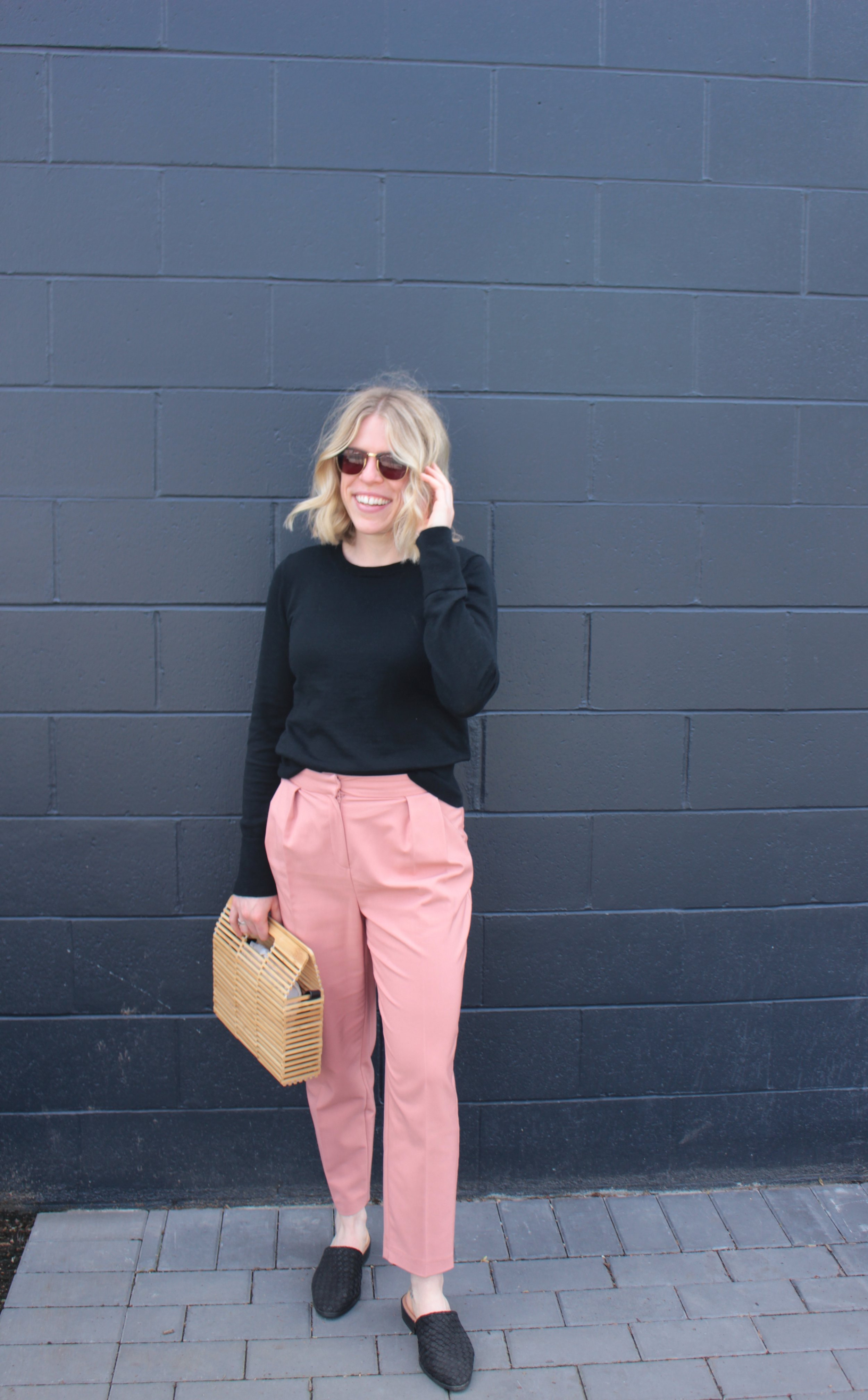Wearing    GAP    Sweater,    Topshop    Trousers,    Marks & Spencer    Slides,    Topshop    Wooden Bag,    Ray Ban    Sunglasses