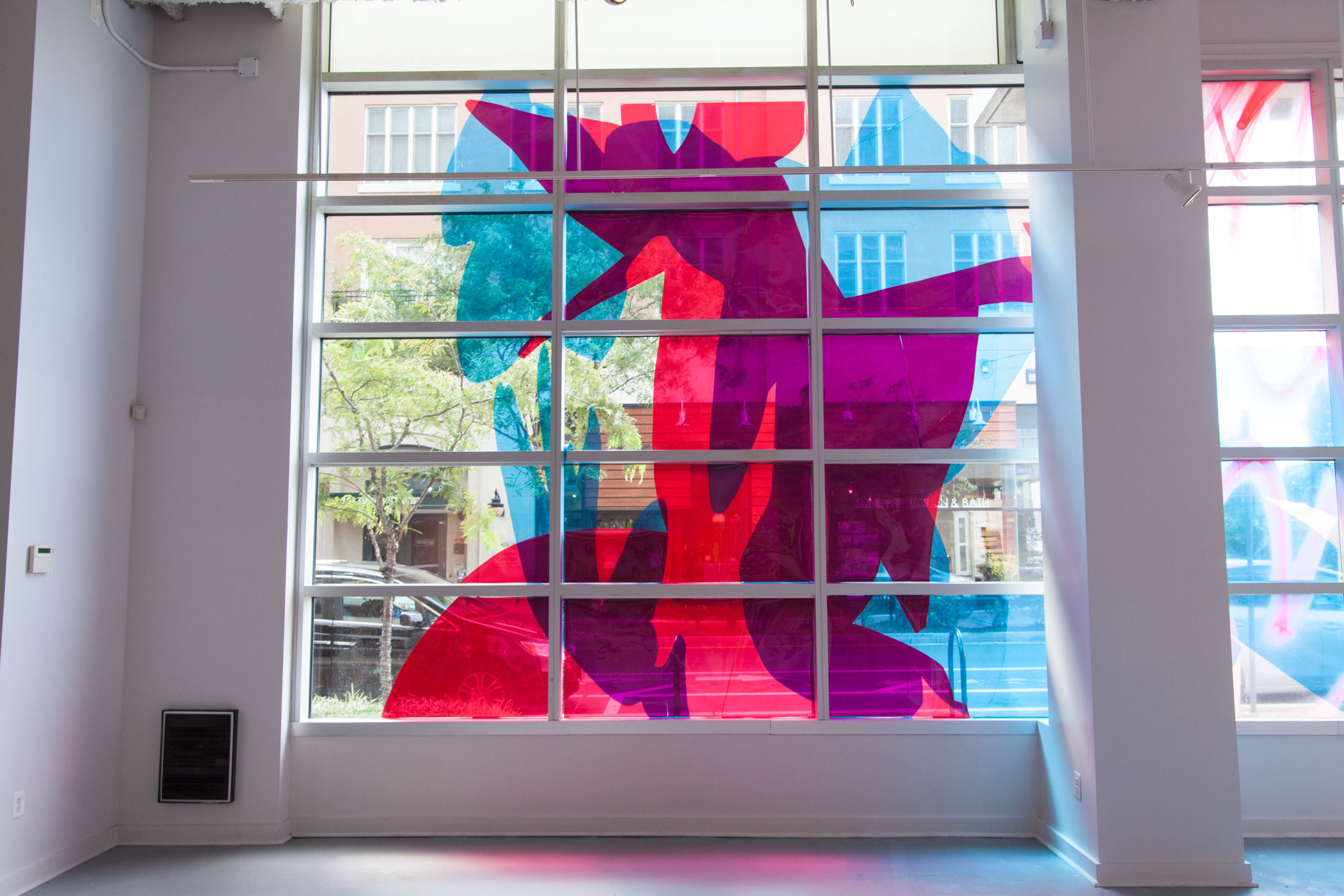Untitled (window installation) , 15 x 45 ft., Dura-lar, spray paint, 2016