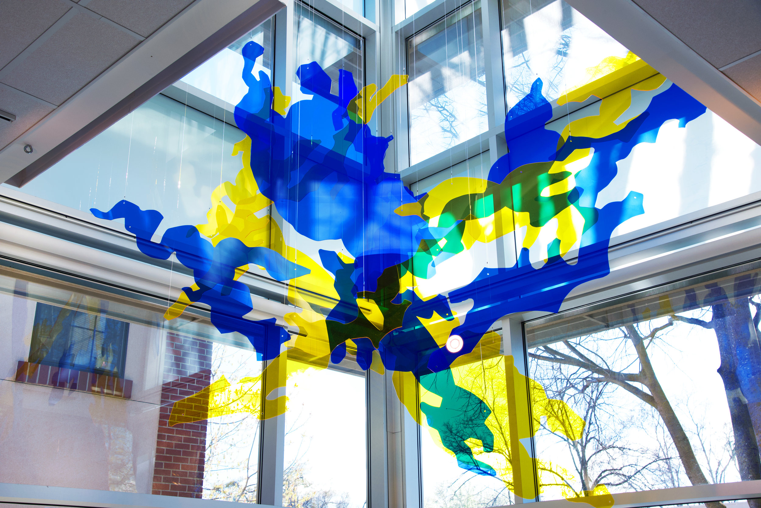 Forming Light , 10 x 10 x 10 ft., Blue and yellow custom laser-cut acrylic pieces, nylon wire, 2018
