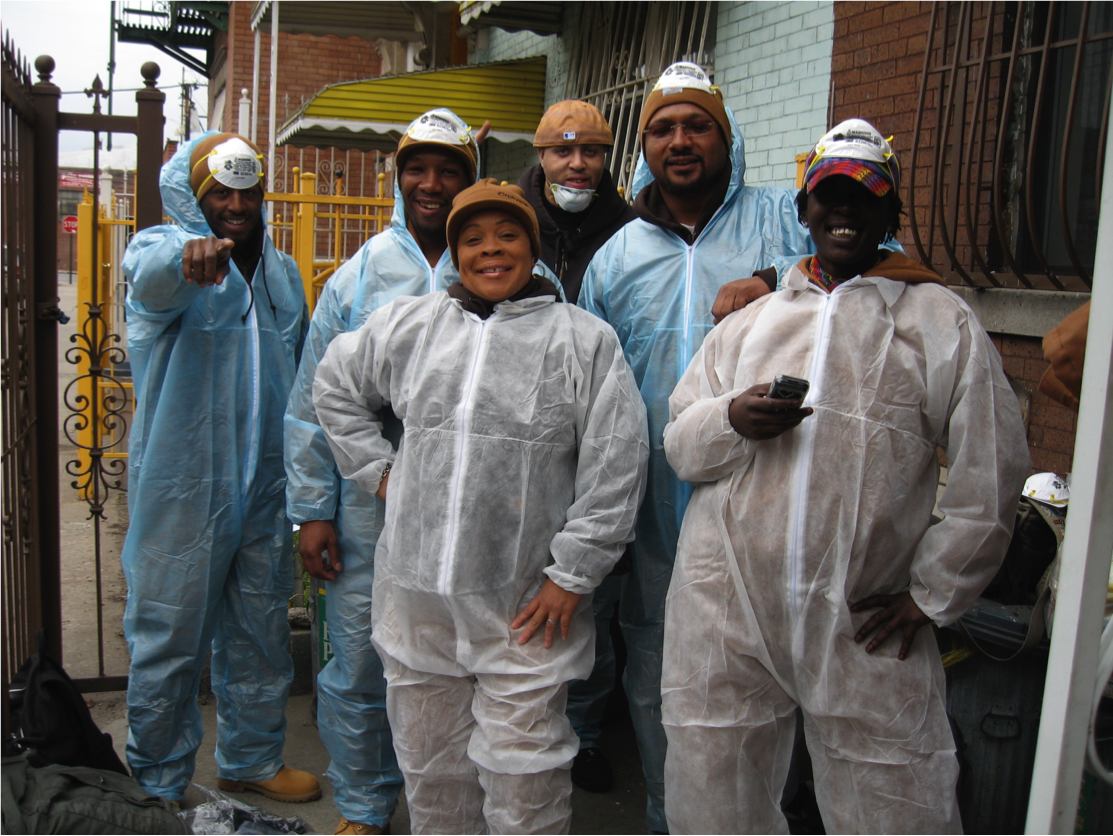 Trainees after completing an energy efficiency home renovation as part of their field training