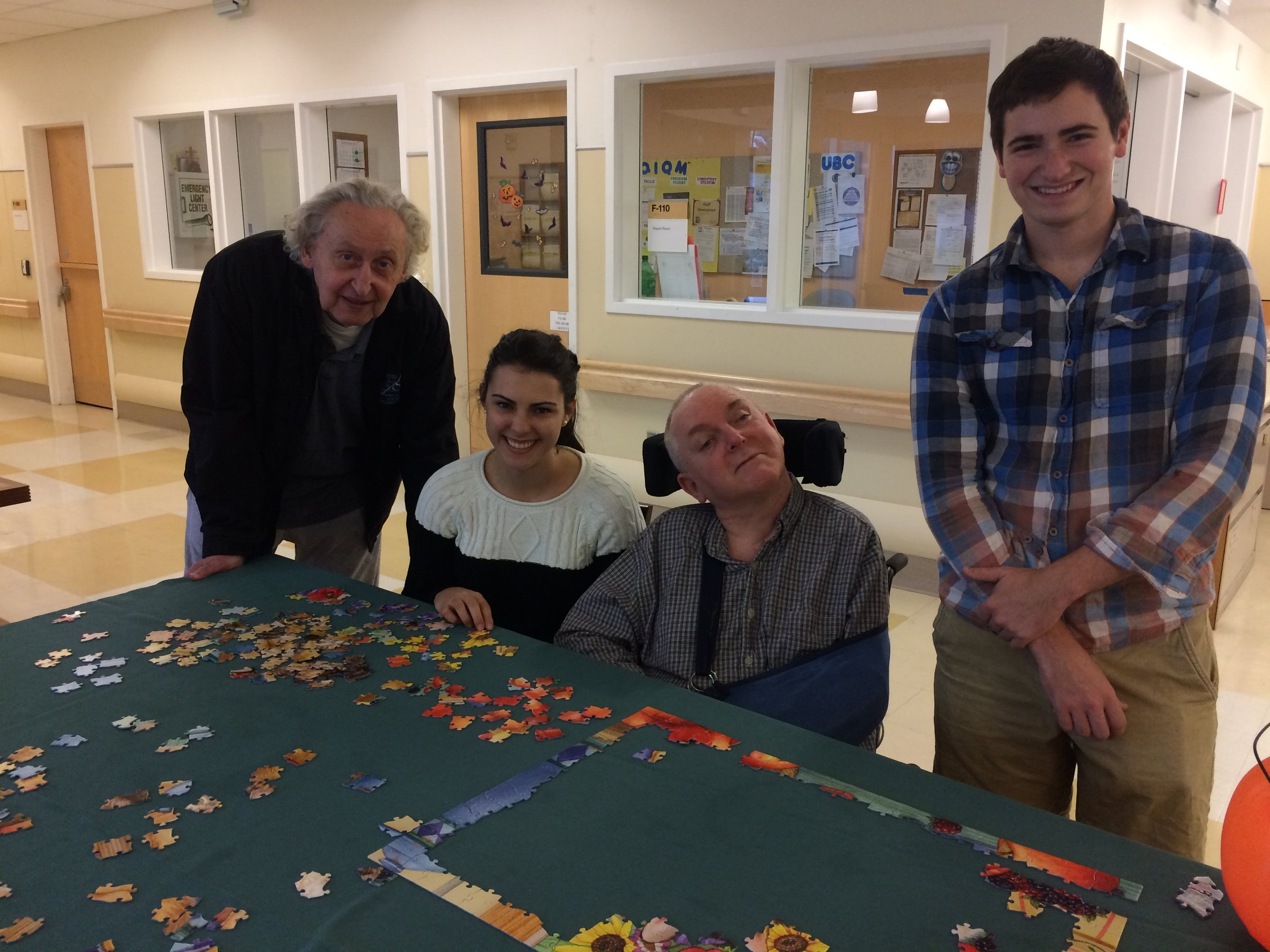 Volunteers building a puzzle with veterans at the Menlo Park Veteran's Hospital.