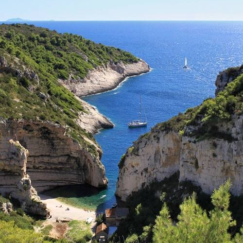 Stiniva Bay on the island of Vis, with views of the open sea beyond.