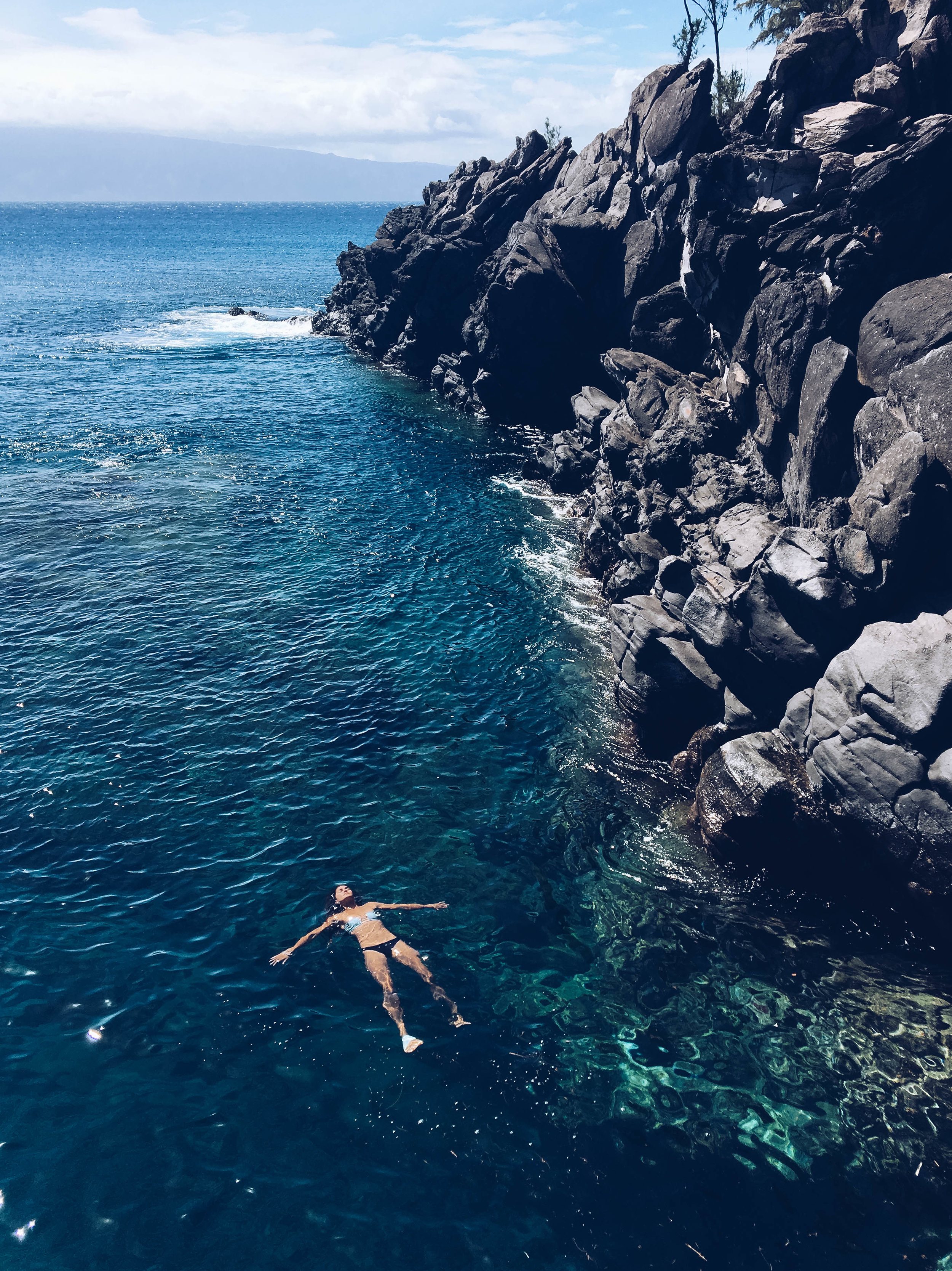 Jumping the rock at Cliff House. The water was like glitter, and so clear and blue!