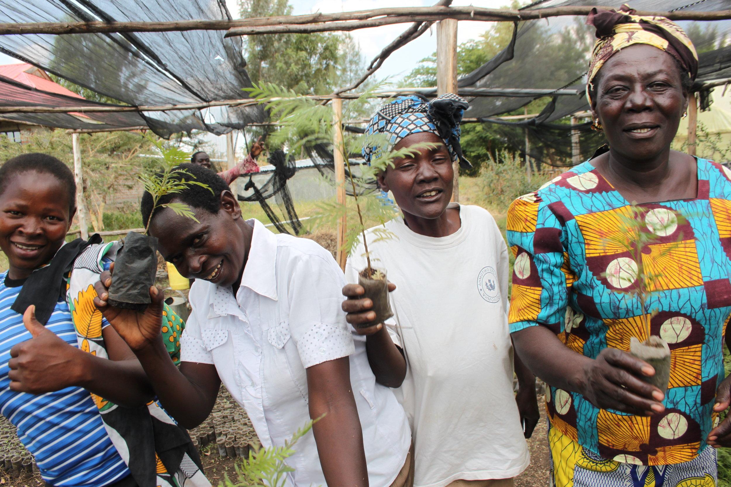 Alara ladies holding seedlings they have grown