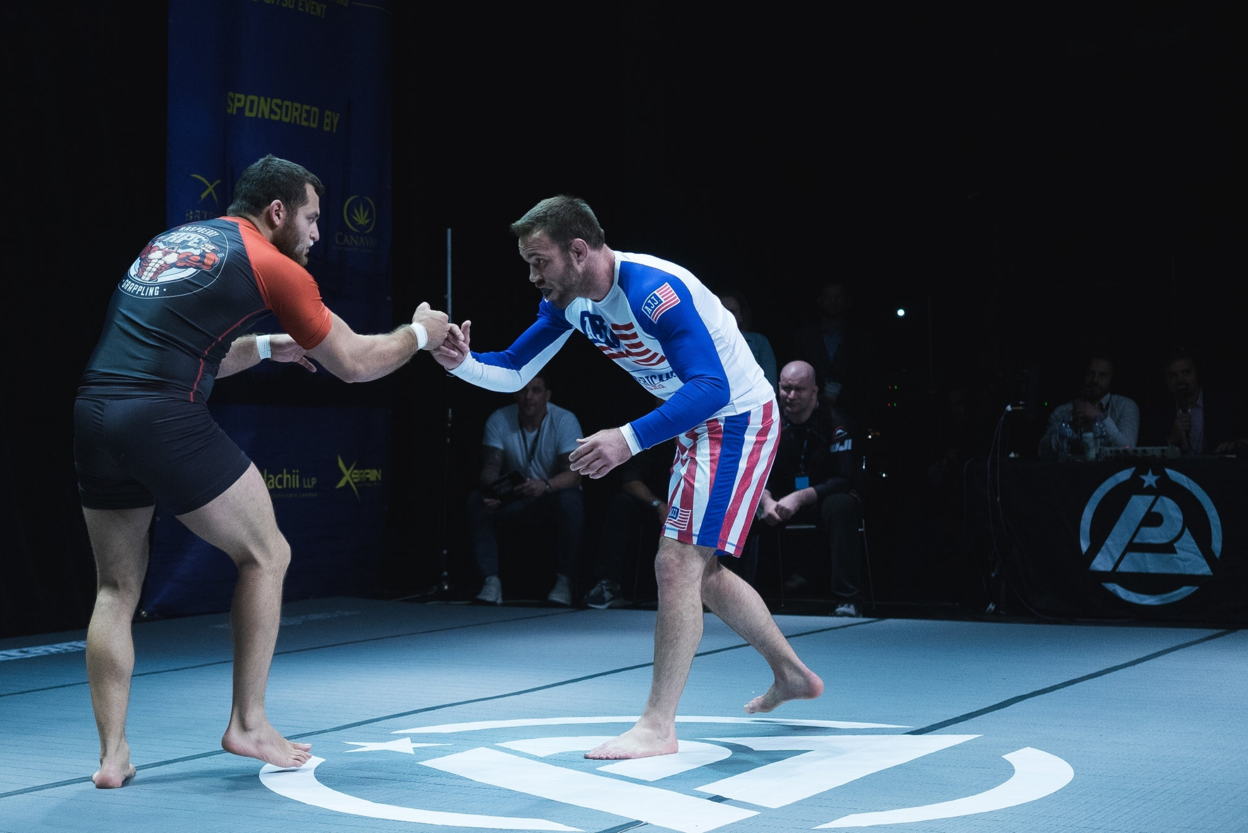 Charismatic UK star Dan Strauss of Mill Hill BJJ, London puts on a game display against grappling maestro and MMA stand-out Jake Shields, but loses by majority decision. Shields' super-coach John Danaher looks on. Photo by  Luke Jarvis  .