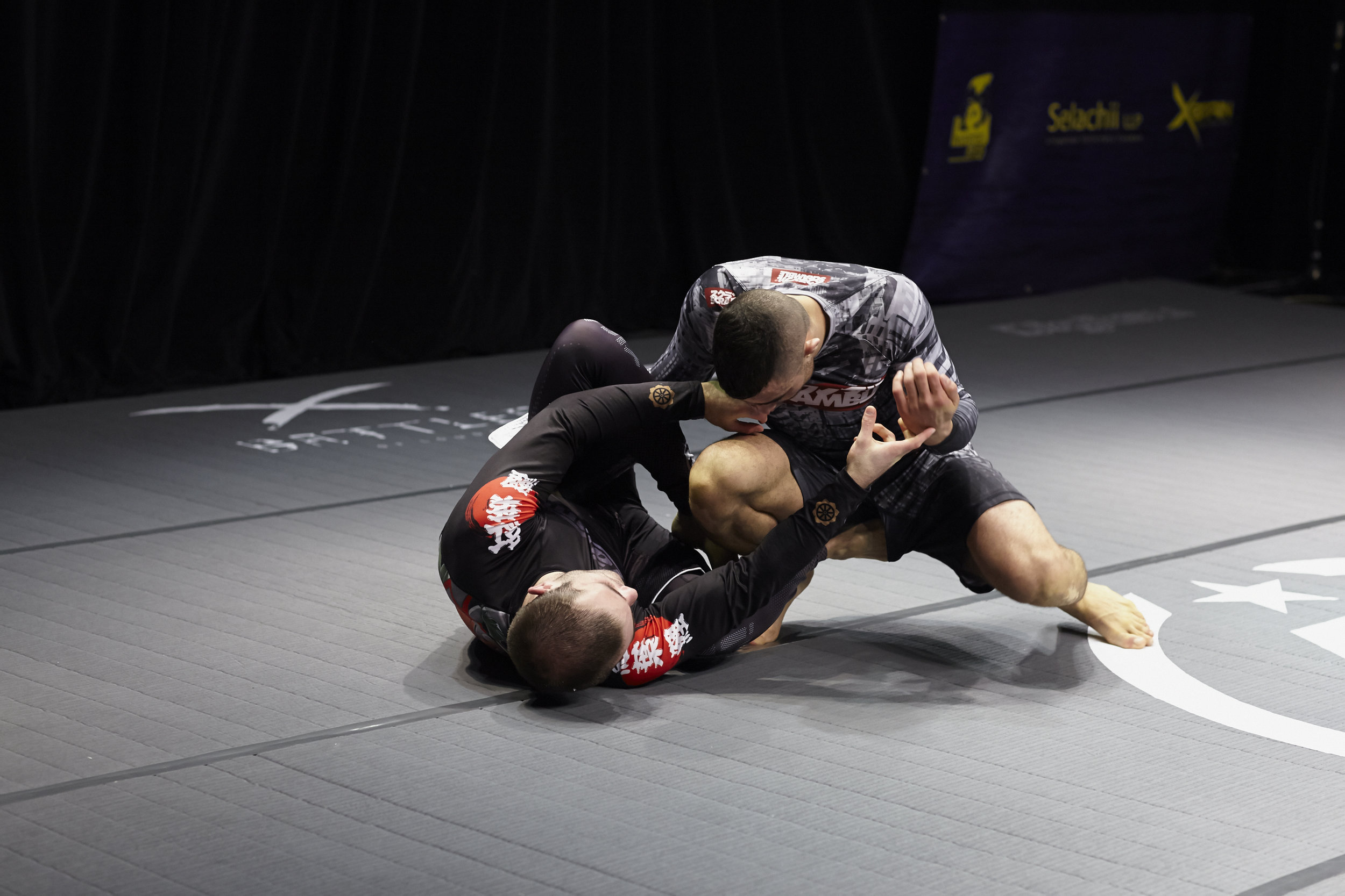 Highly rated British black belt under  Roger Gracie , Ross Nicholls grapples Manhattanite John Danaher's student Oliver Taza. The match saw two of the most promising students, from two of the world's top trainers, demonstrate their ample skills before Taza took a decision win.