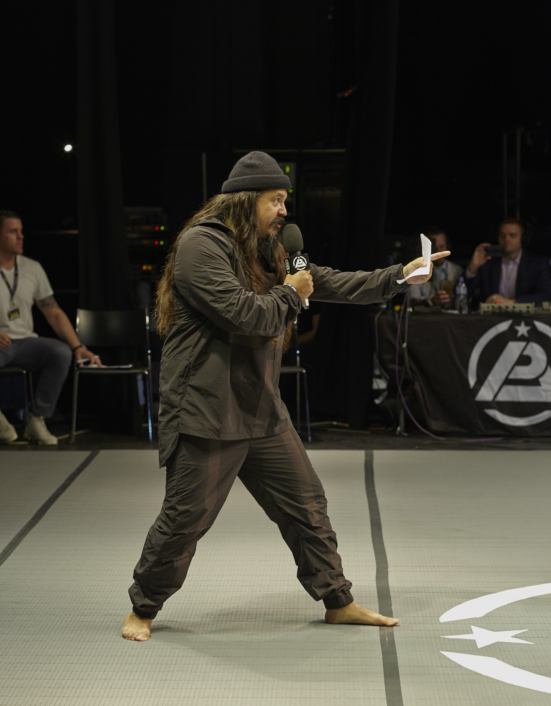 """Announcer Tone Anderson lets the Polaris crowd in on """"Elite clothing for combat sports aficionados…"""""""