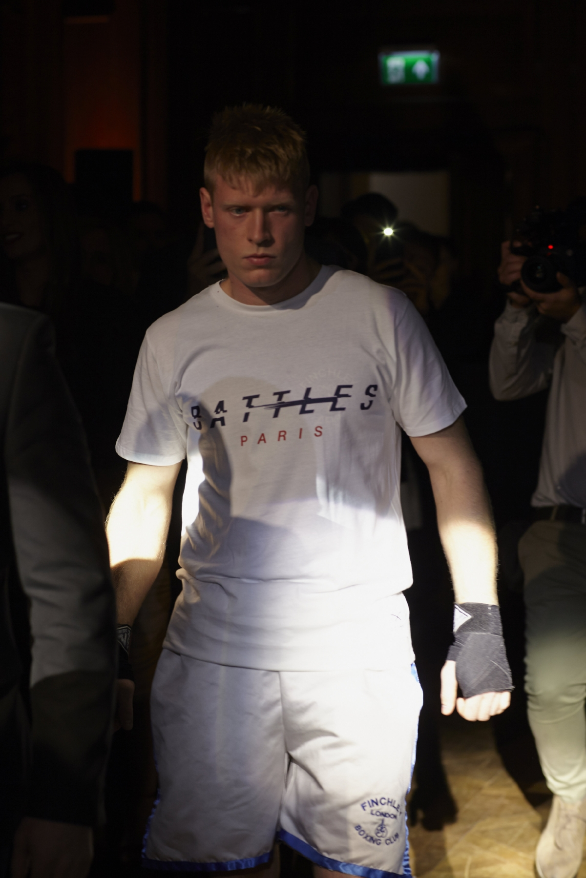 Gardener Jack Johnstone, a former MMA fighter training at Finchley ABC, walks in wearing our 'Dempsey' T-shirt in Battles of Paris livery