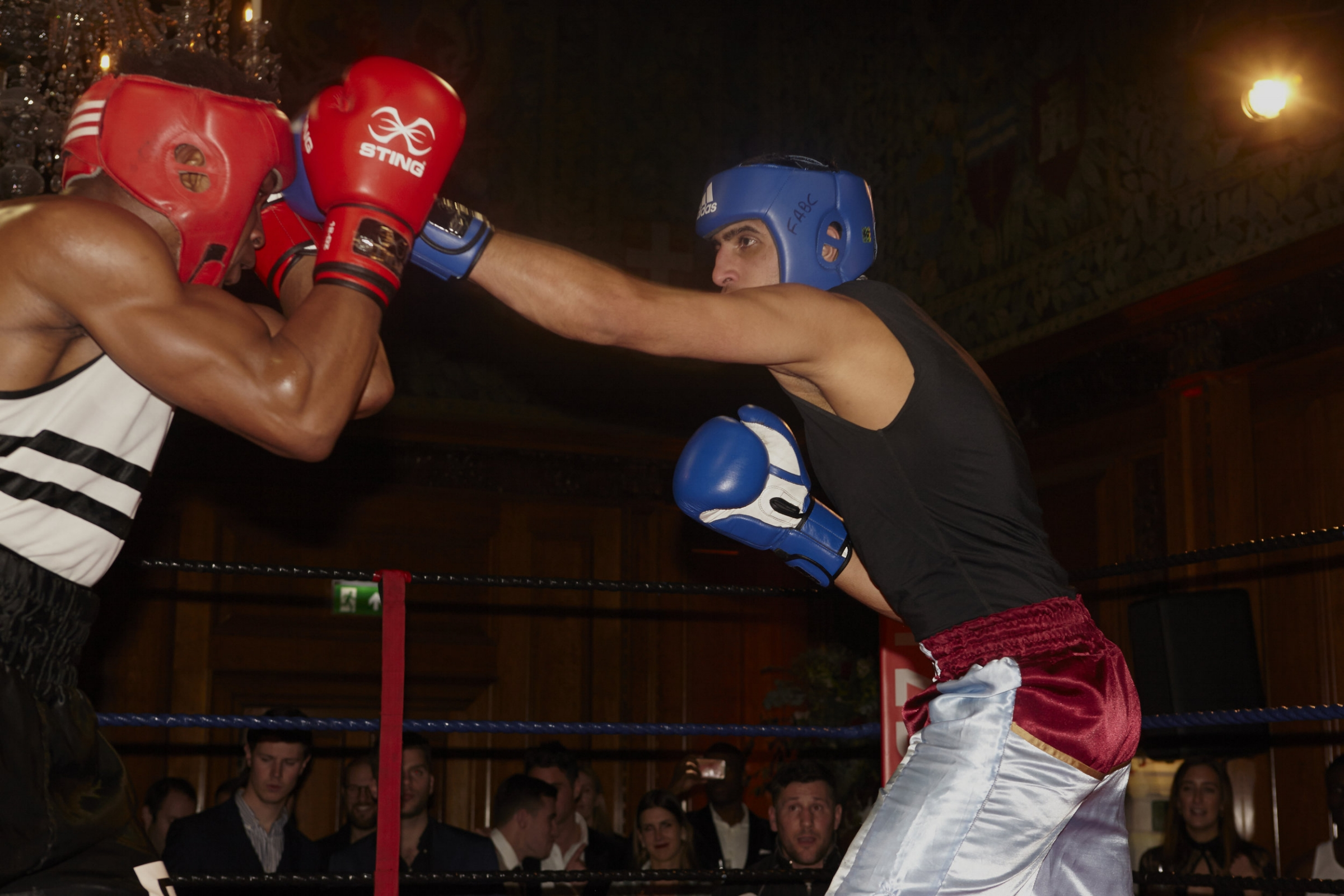 In the third bout, Lewsey's Shafqat Khan fires a long jab at Fitzroy Lodge's Tosin Olalekan