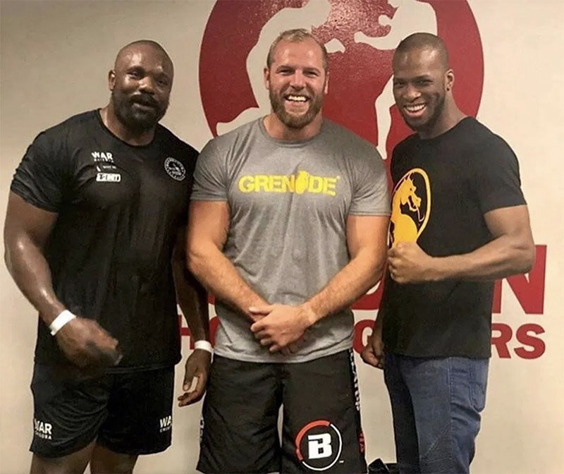 Haskell (centre) at London Shootfighters gym with Bellator stand-out Michael 'Venom' Page (right) and boxer Derek Chisora