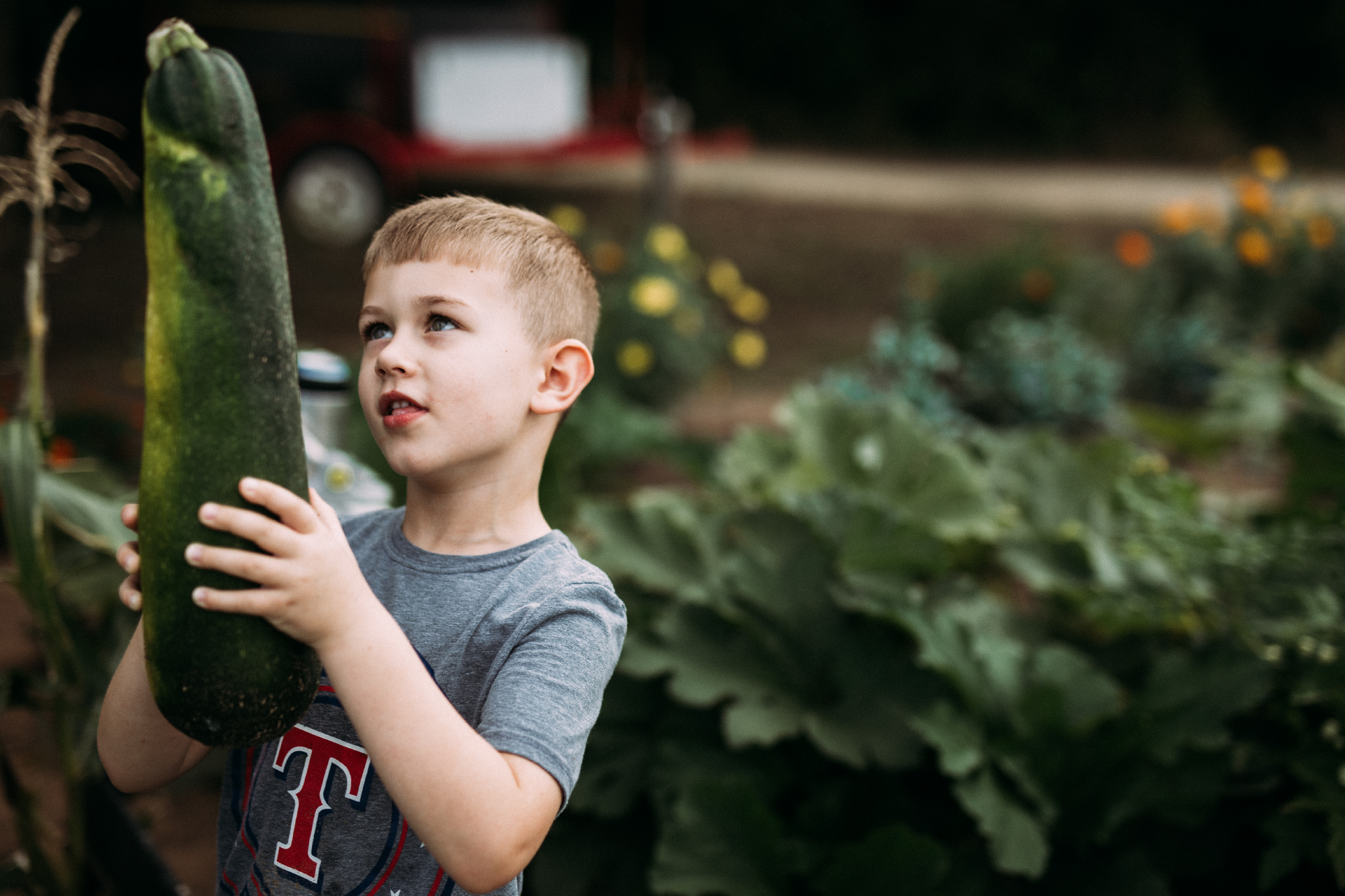 Big brother handles the really big ones | Rural Life Photography | Family Photojournalism