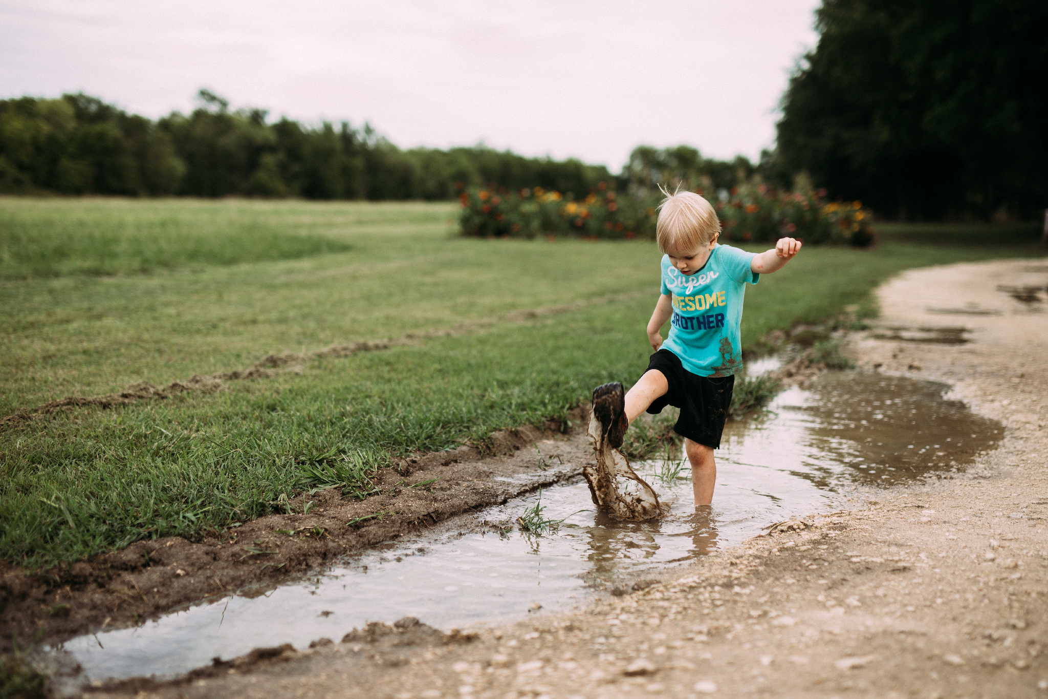 There is always time to play in muddy puddles | Rural Life Photography | Family Photojournalism