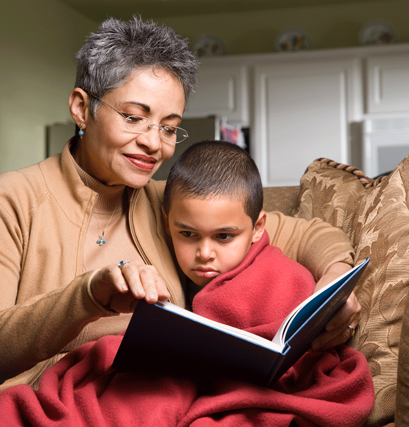 woman reading to young boy