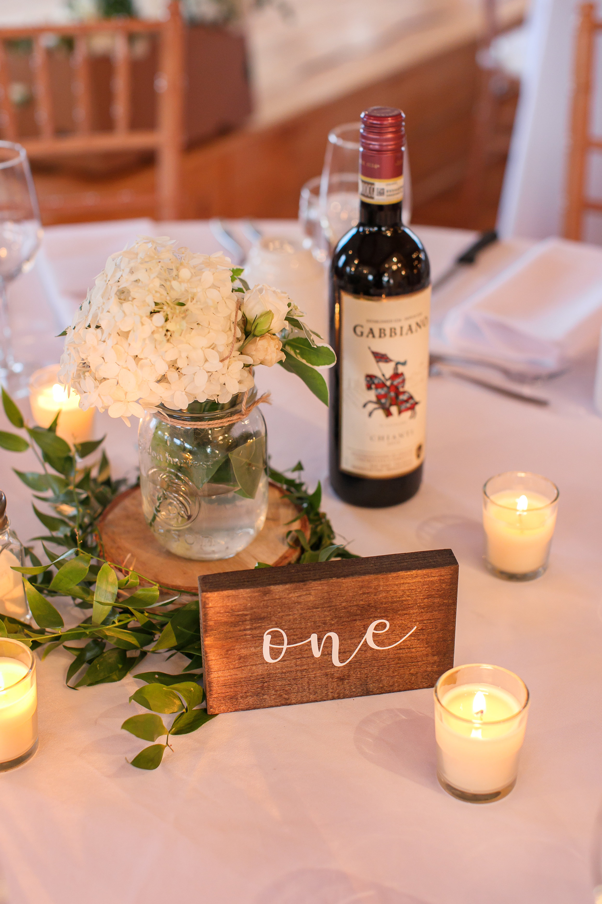 Wooden script table numbers  Photo by  Brady McCloskey Photography