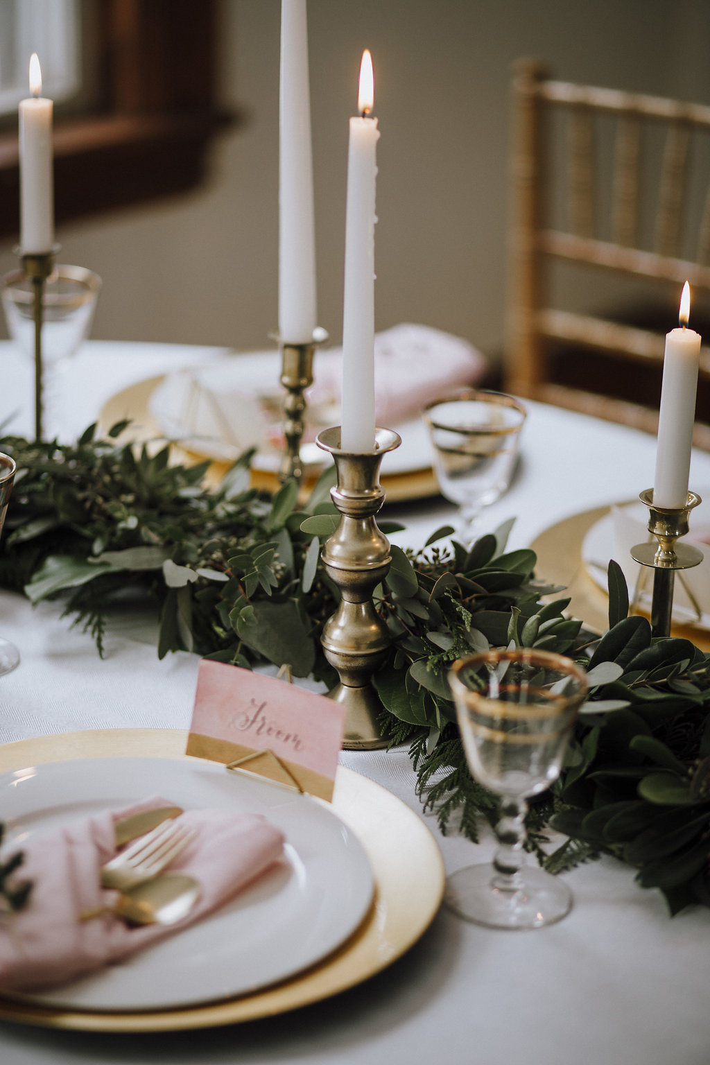 Assorted vintage brass candlesticks in many heights and styles  Photo by Melissa Harding Photography