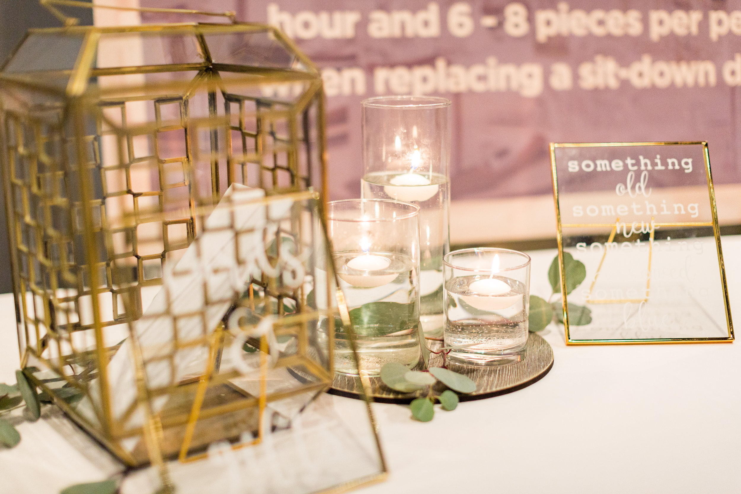 Gold & glass lantern card box  Grey wooden charger plates  Assorted size cylinder vases  Custom gold & glass frame signage  Photo by  Jenna Rachelle Photography