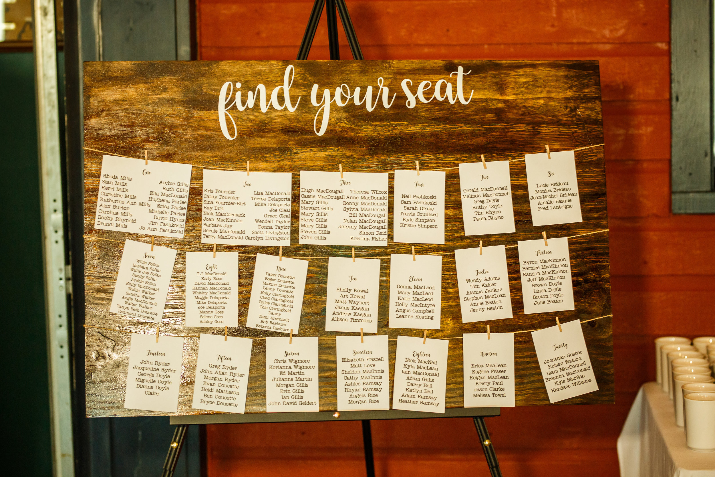 Large dark stain seating chart  Photo by  Simon Reid Photography