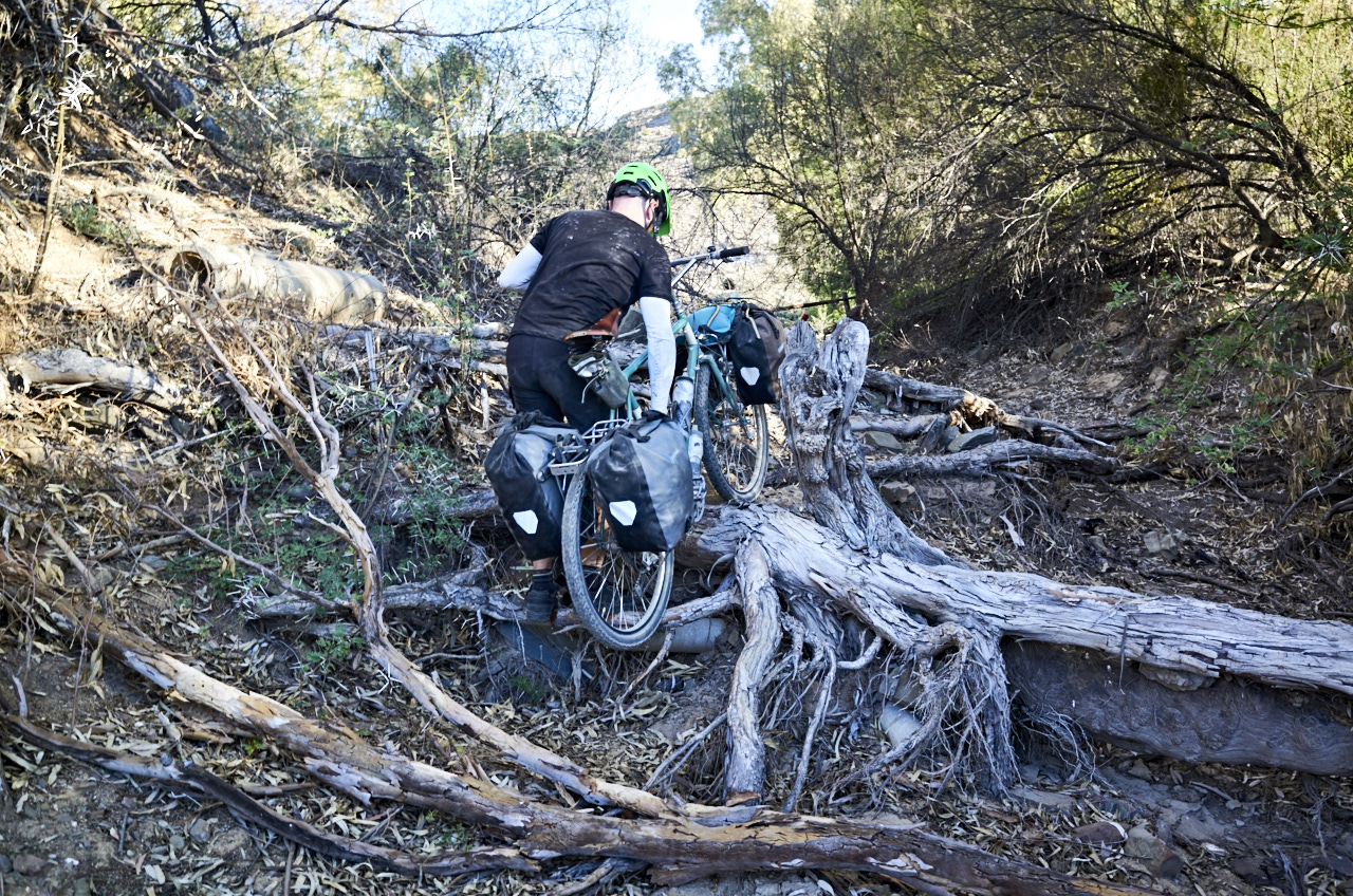 We found a great secluded spot to wild camp in a dried up riverbed, it did however involve us having to portage our bikes over some tricky log sections.