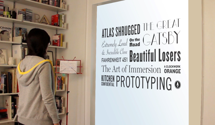 Projected, full scale, prototype of the book wall showing the library title view.