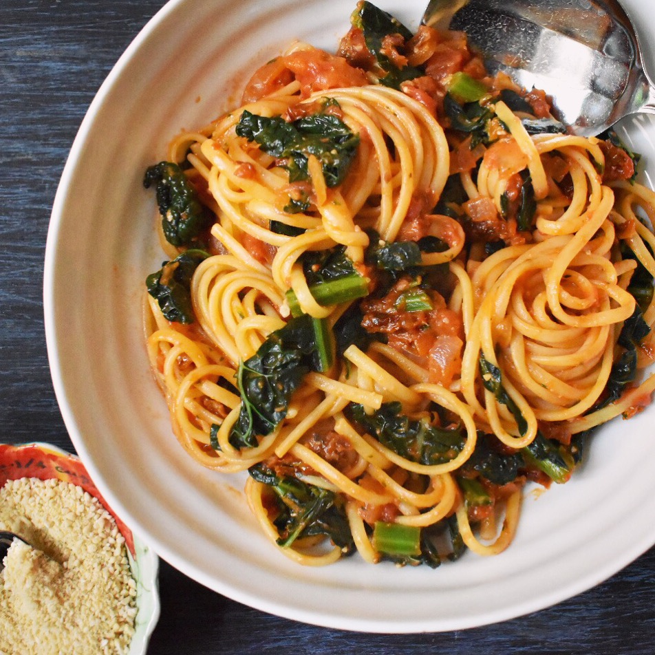 Vegan sun-dried tomato pesto linguine with vegan parmesan cheese