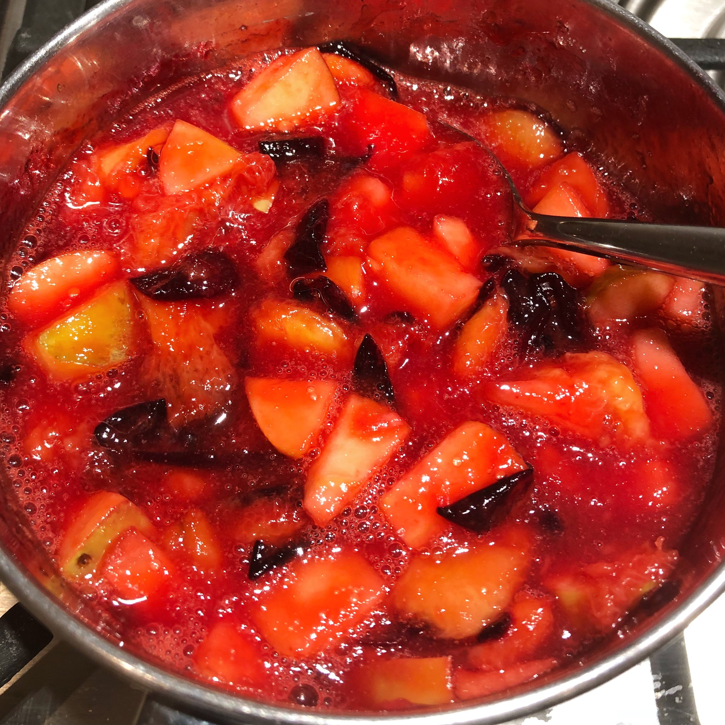 The plums starting to break down and become syrupy. I added some chopped apples to the plums in this chia seed jam