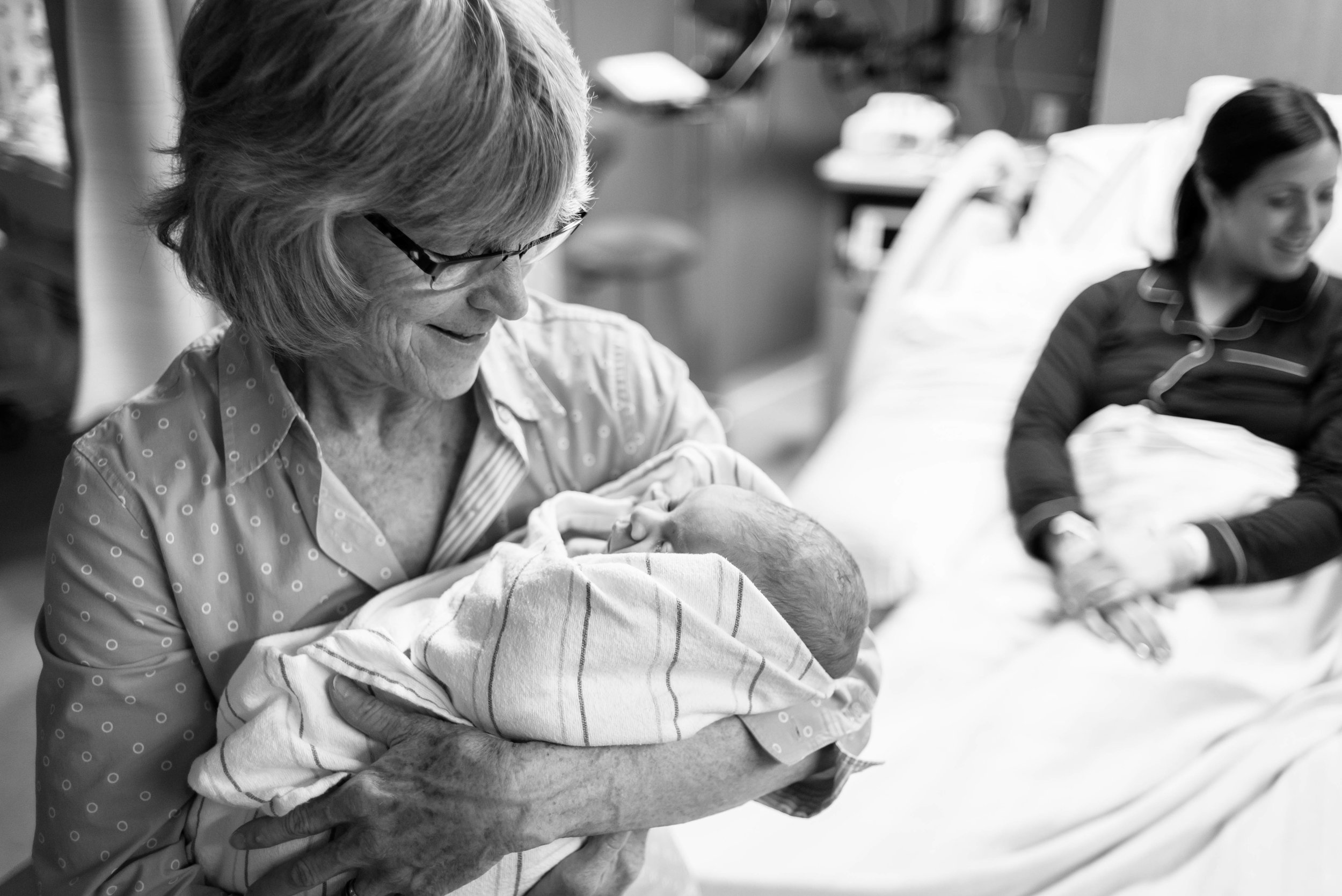 grandma meeting her newest grandbaby