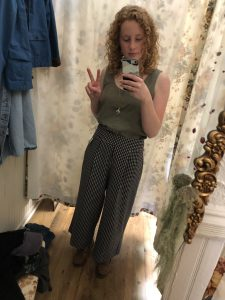Me in a pair of super cool thrifted wide-leg trousers that I paired with a green Patagonia tank and a long necklace from Consume With Love