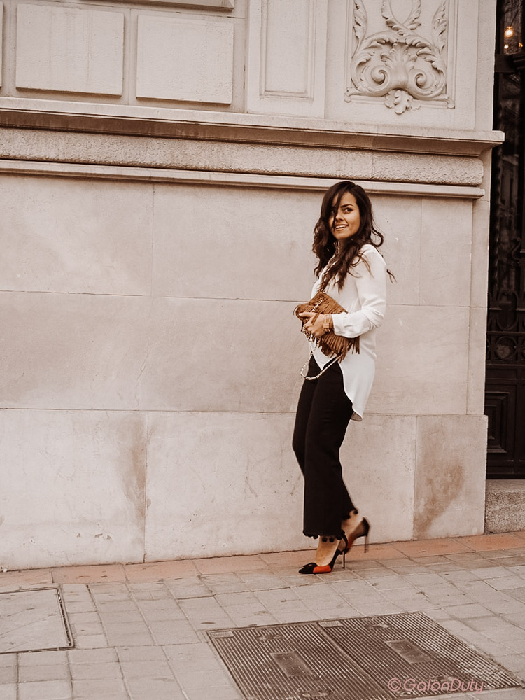 silk blouse with fringe purse and statement shoes