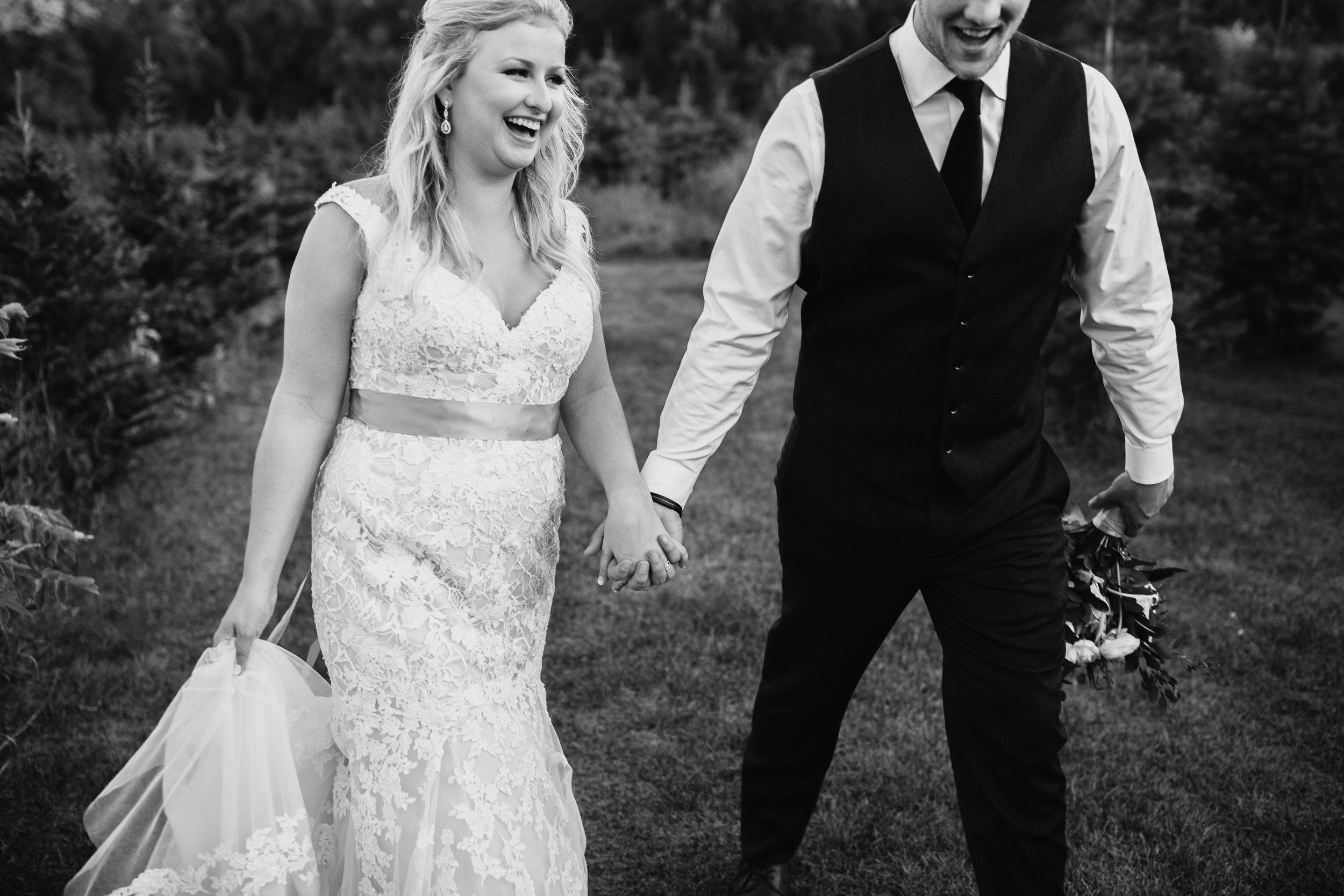 55 laughing bride and groom.jpg
