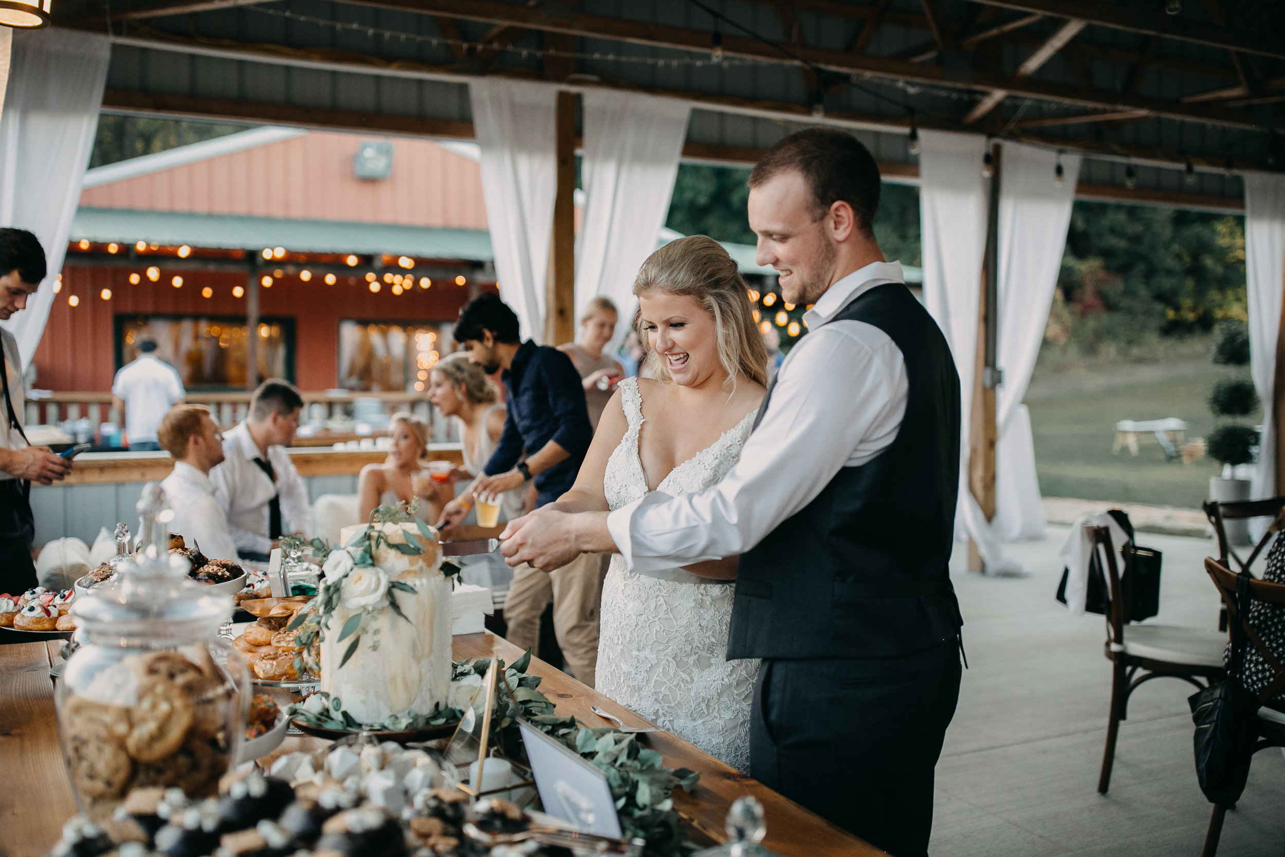 60 bride and groom cutting cake.jpg
