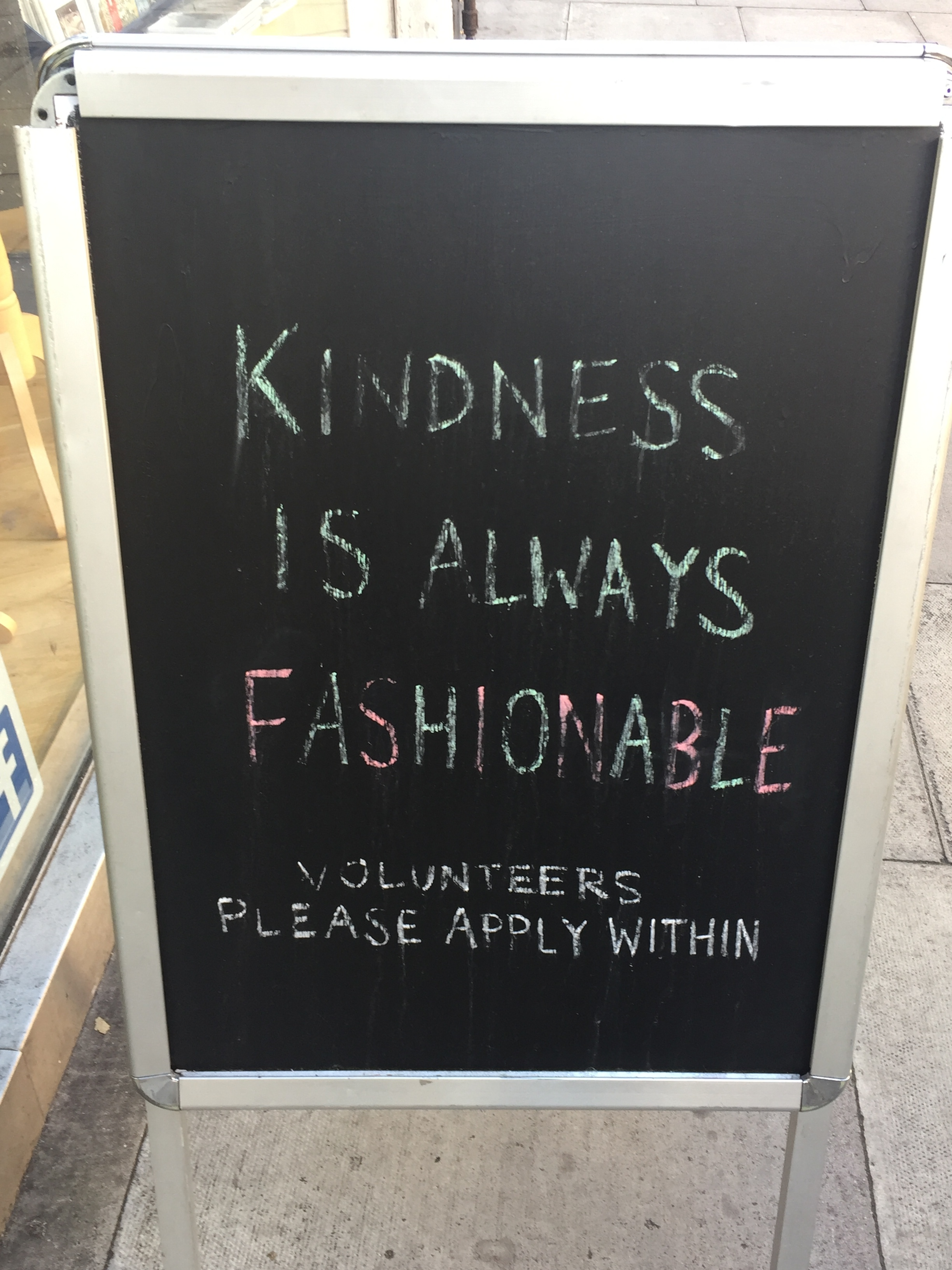 I saw this sign today outside of the  Mind  charity shop on Fulham Road