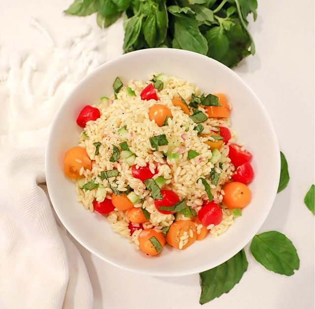 Summer in a Bowl  Salads are perfect for a quick meal or a side dish for a summer cookout. With farmers markets in season, it couldn't be a better time to toss your favorite ingredients in a bowl.  My orzo salad is always a favorite with my boys, family and friends. Add these ingredients to your basket the next time you're at your local market or grocery store and follow my quick recipe.  Boil 2 cups water and 2 cups beef broth - the orzo absorbs the broth flavor and creates another depth of deliciousness.  While the water and broth are boiling... Add all the below ingredients into a bowl:  1 lb cherry tomatoes, chopped in half 1/2 of a large shallot, diced 1 seedless cucumber, peeled and diced 1 cup fresh basil, chopped 1/4 cup red wine vinegar 1/2 cup of extra virgin olive oil 2-3 tsp kosher salt 1 tsp cracked pepper  Let the orzo cool then toss with all the other ingredients. Buon Apettito !