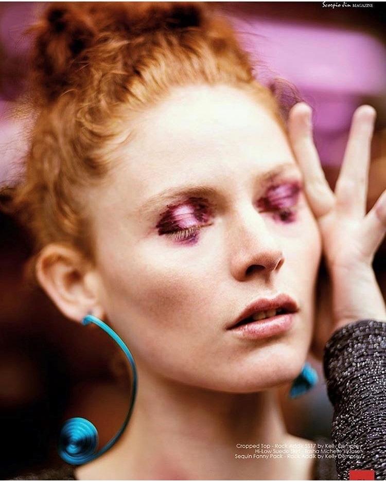 """Model is wearing the """"  Ti Mòn  """" reversible hoop earrings"""