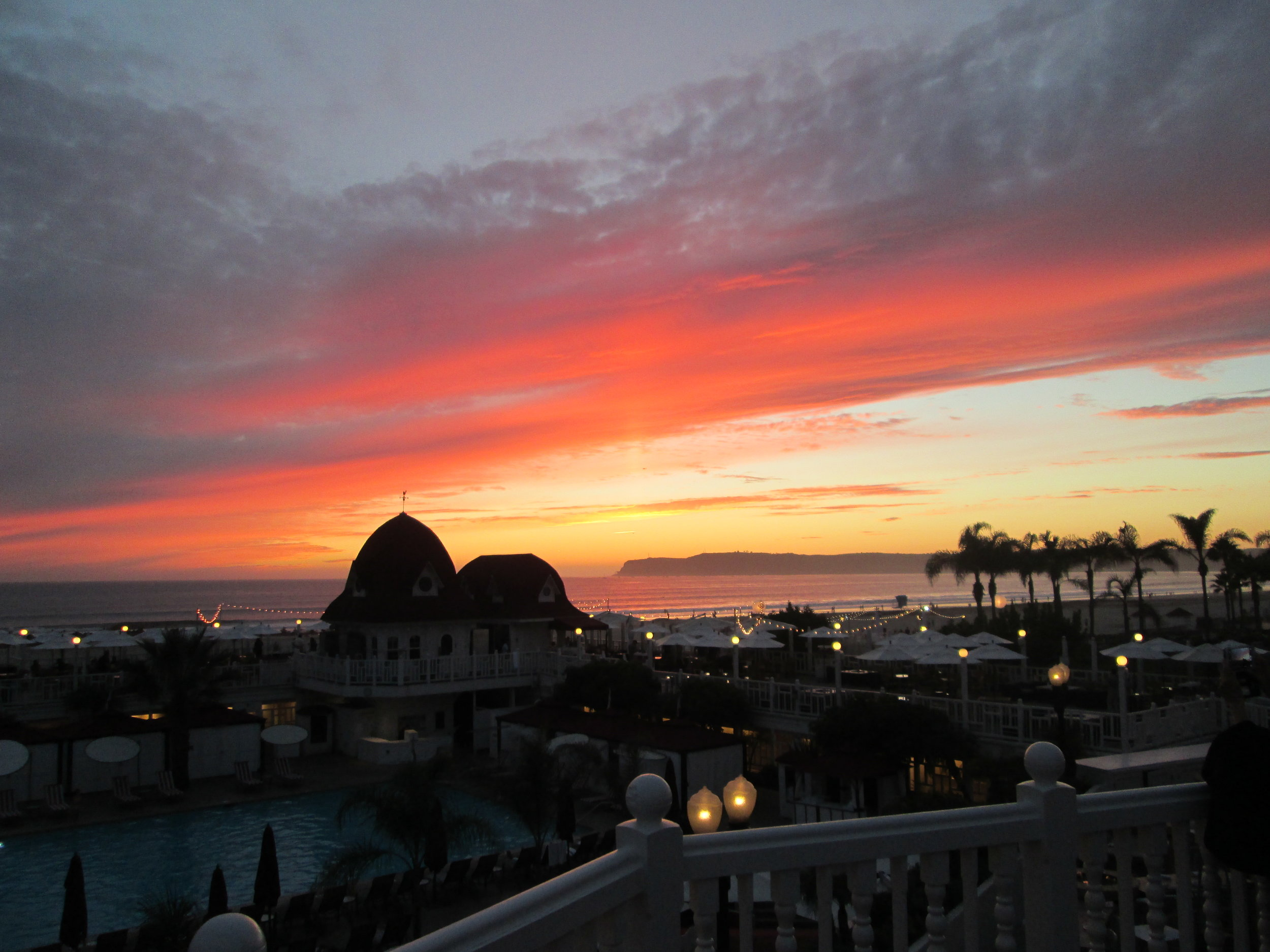 Here's a sunset at the lovely Hotel del Coronado. Walking barefoot on the beach in November is not too shabby. Nice going, California!