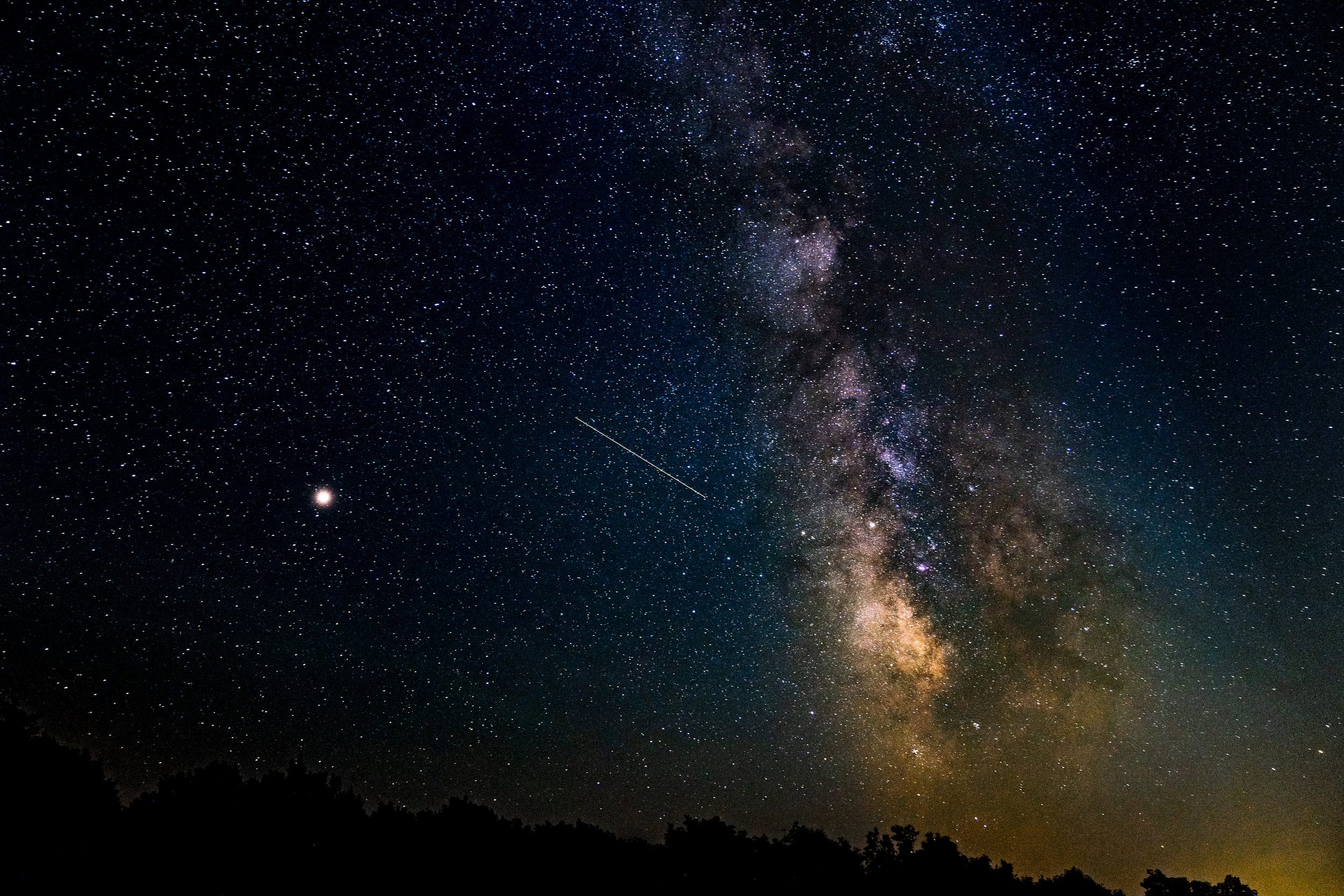 The Milky Way with a shooting star and Saturn over Shenandoah National Park.