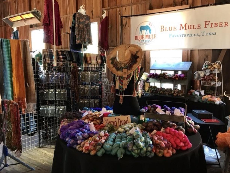 Blue Mule Fiber Shawls and yarn set up