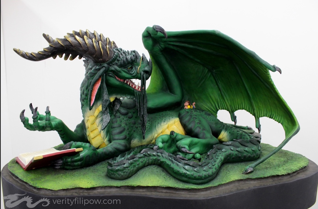 Verity of Creature Cave's amazingly detailed dragon reading to a child sculpture.