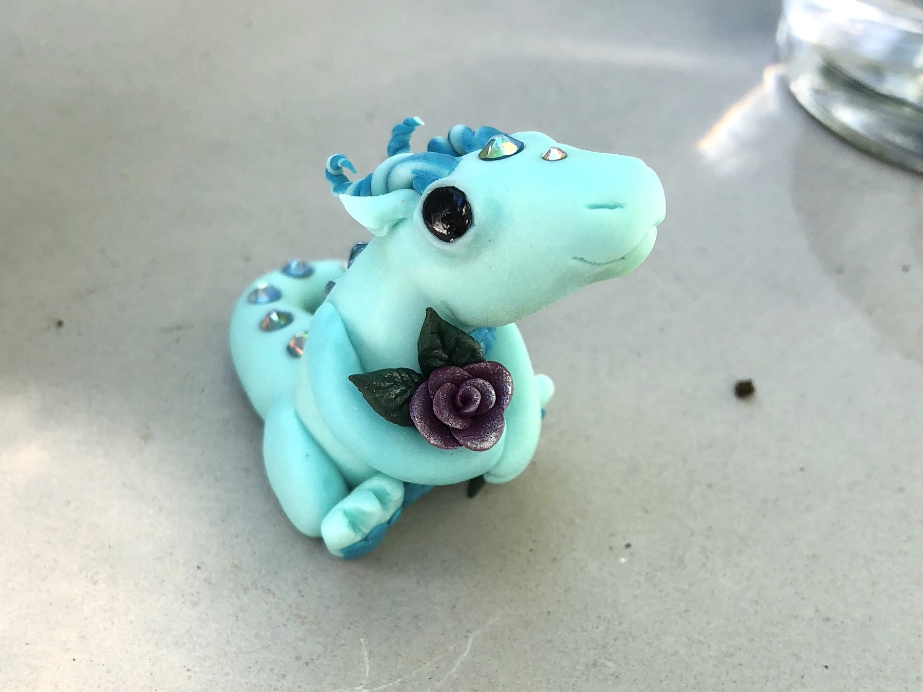 Amanda of Daylight Creations adorable glow in the dark dragon with Swarovski and a beautiful rose.
