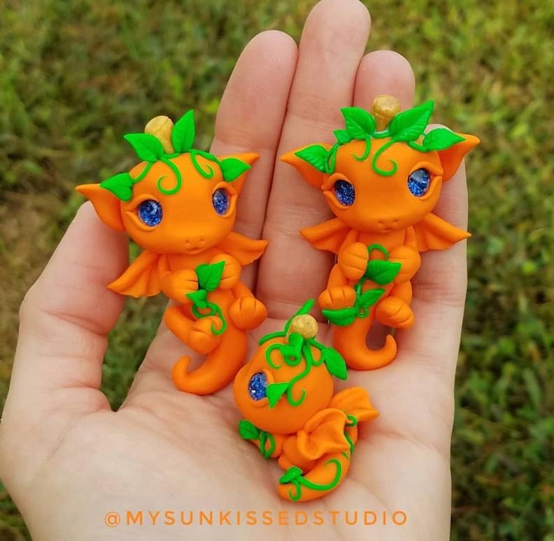 Pumpkin patch clay dragon sculptures