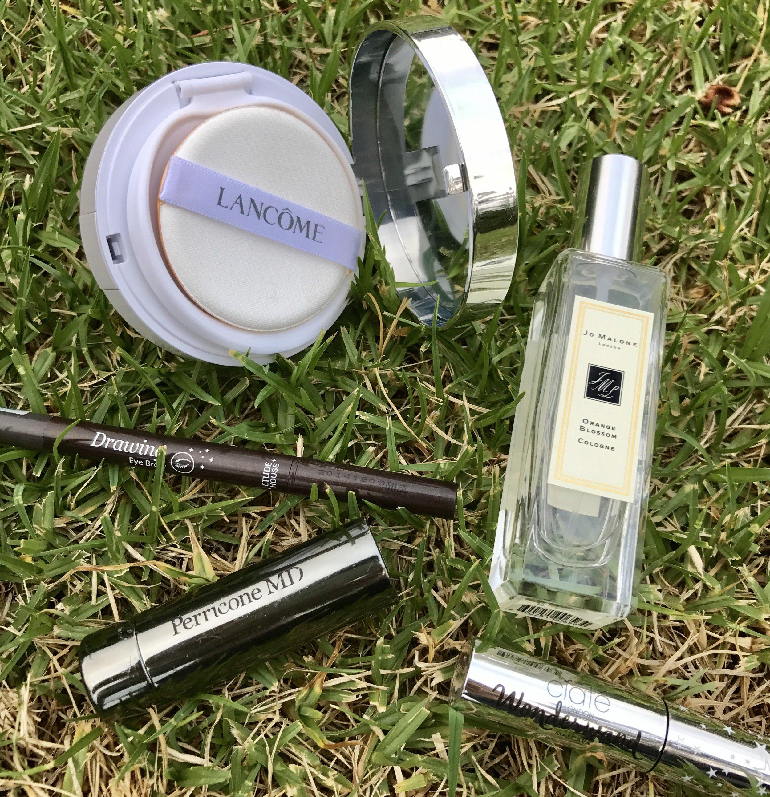 Products clockwise: Lancome Miracle Cushion 04, Jo Malone Orange Blossom, Ciate Wonderwand, Perricone No Lipstick Lipstick, Etude House Draw Eyebrow