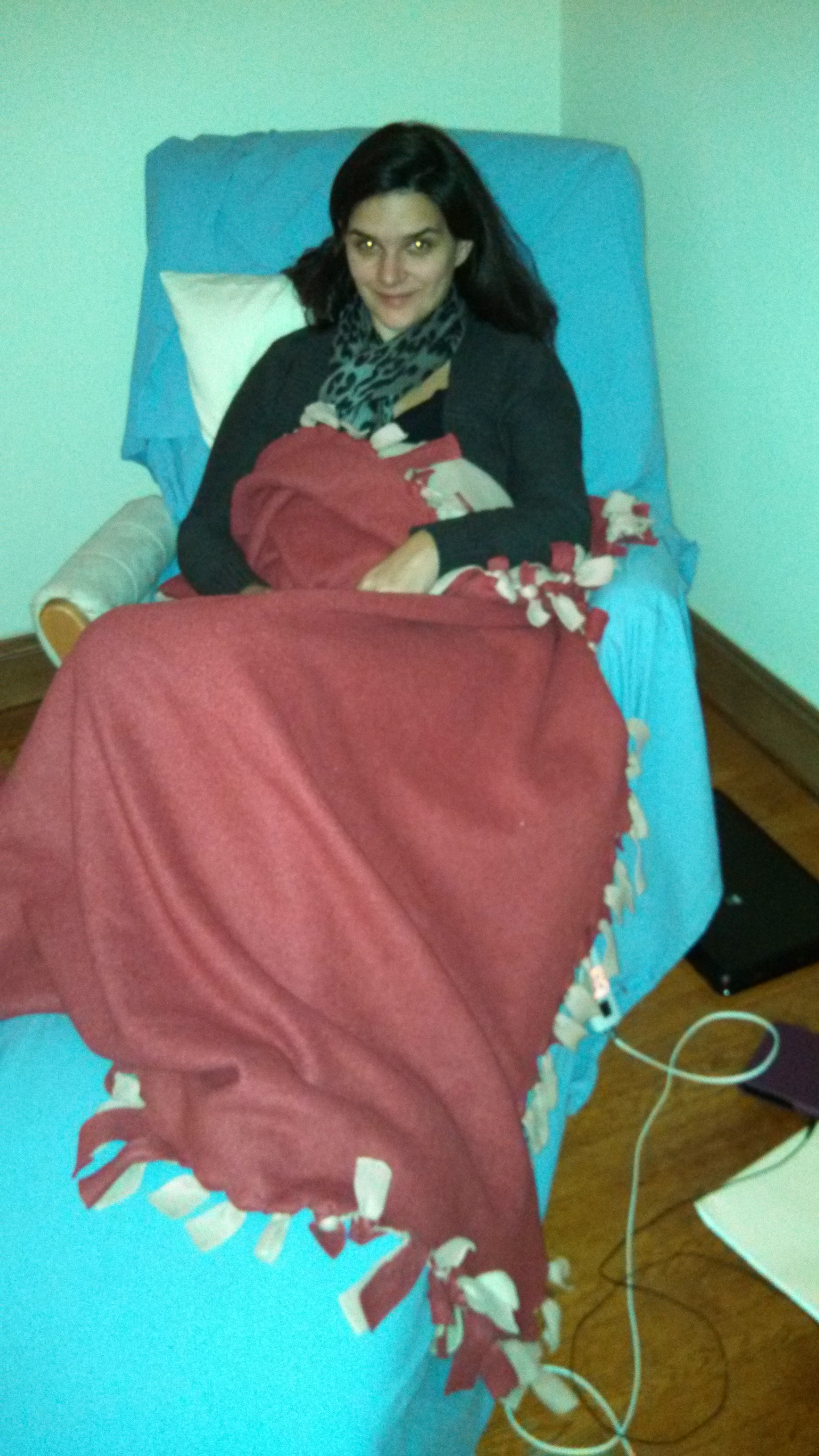 This is me recovering after my second excision surgery with Dr. Tamer Seckin. Note the recliner and the heating pad chord.