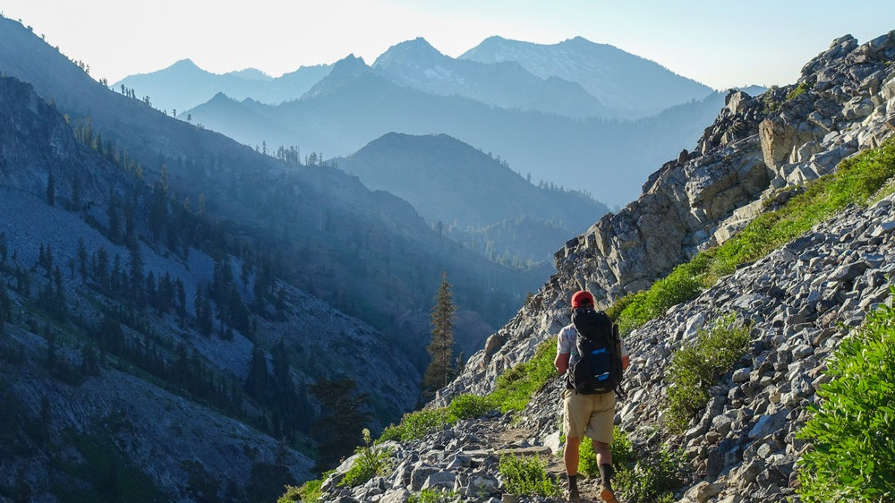 Trinity Alps -     CLICK HERE TO SIGN UP      Number of participants (tickets): 9    Ticket Price:   FREE! (with deposit required)    Trip Description:  Howdy New Wildings! Come join us and your fellow first years for some Intermediate Backpacking in the Trinity Alps. The Trinity Alps mixes the beauty of the Pacific Northwest with the magnificence of the Sierra mountains, so they're a perfect place to go to get to know the California wild. We will complete the Four Lakes Loop trail, backpacking through alpine meadows, crystal clear lakes, and green, green forests. Don't be fooled, there's a whole lot of elevation to gain, so this trip is not for faint of heart. This trip is perfect for those who love seeing the stars, making new friends, and adventuring in the great outdoors. We strongly recommend previous backpacking experience or extensive hiking experience.  We will depart from campus the morning of Wednesday, September 18th and drive north to Shasta- Trinity Alps National Forest, then hit the trails to hike 5 miles with 2,000 feet of elevation gain to our campsite at Echo Lake. On Thursday, we'll traverse mountains, lakes and meadows on a lovely 7 mile hike, reaching Siligo Meadows. On our last day, we'll trek the final 7 miles back to the trailhead, then drive back to Santa Clara. We're stoked to adventure with you as you start your time here at Santa Clara! Get up, get out, get wild!   Activities:  Hiking/Backpacking, Camping   Experience/Fitness Level:  Intermediate Backpacking; Backpacking experience is highly recommended; Hiking experience and being in good shape is a must as well we be covering 5-6 miles a day with large elevation gain.   Leaders:  Kirsten Dodroe, Pierce Klinke, and Nick Keenan