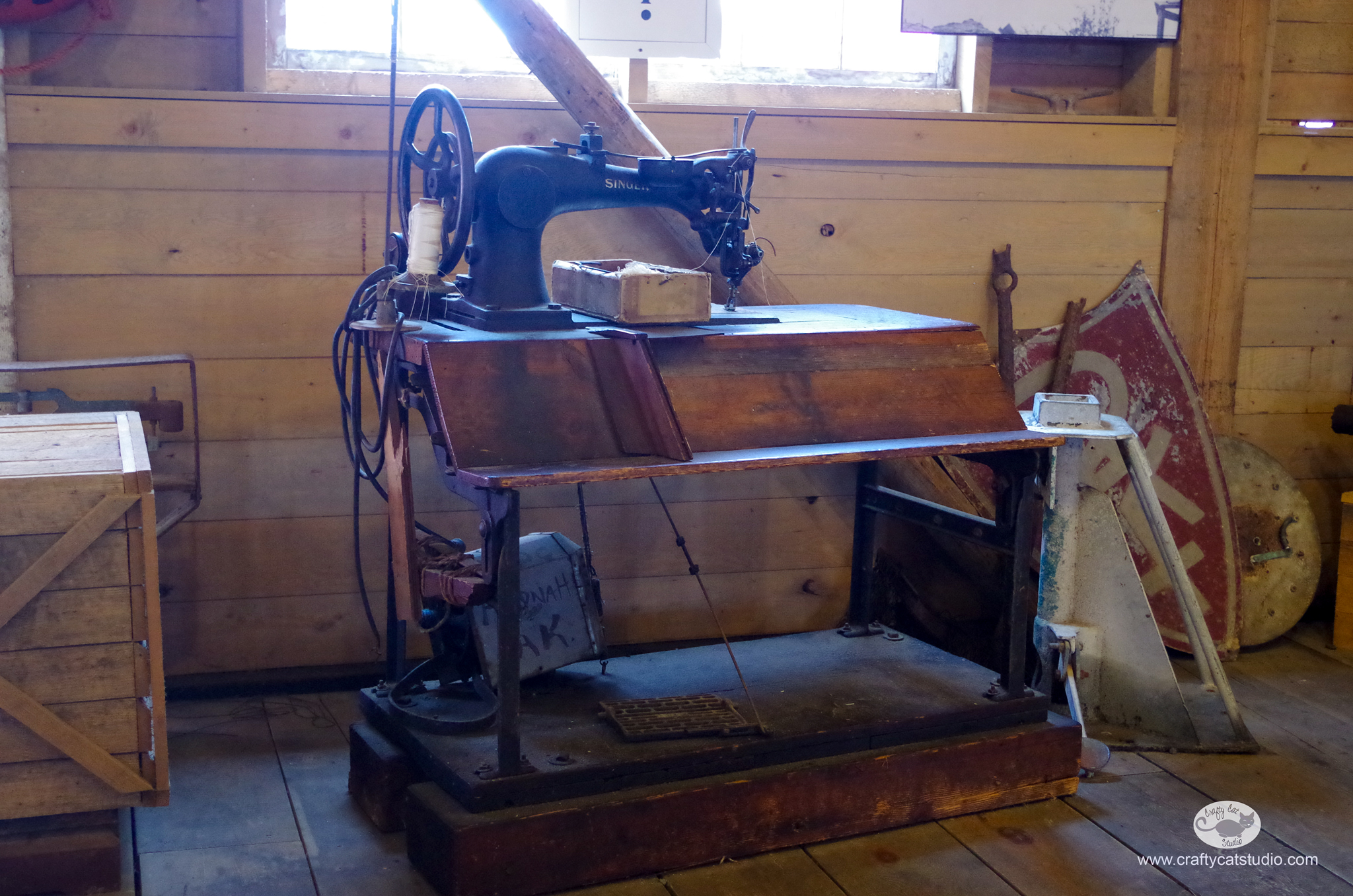 A vintage industrial Singer sewing machine on display in the Cannery Museum on Icy Strait Point