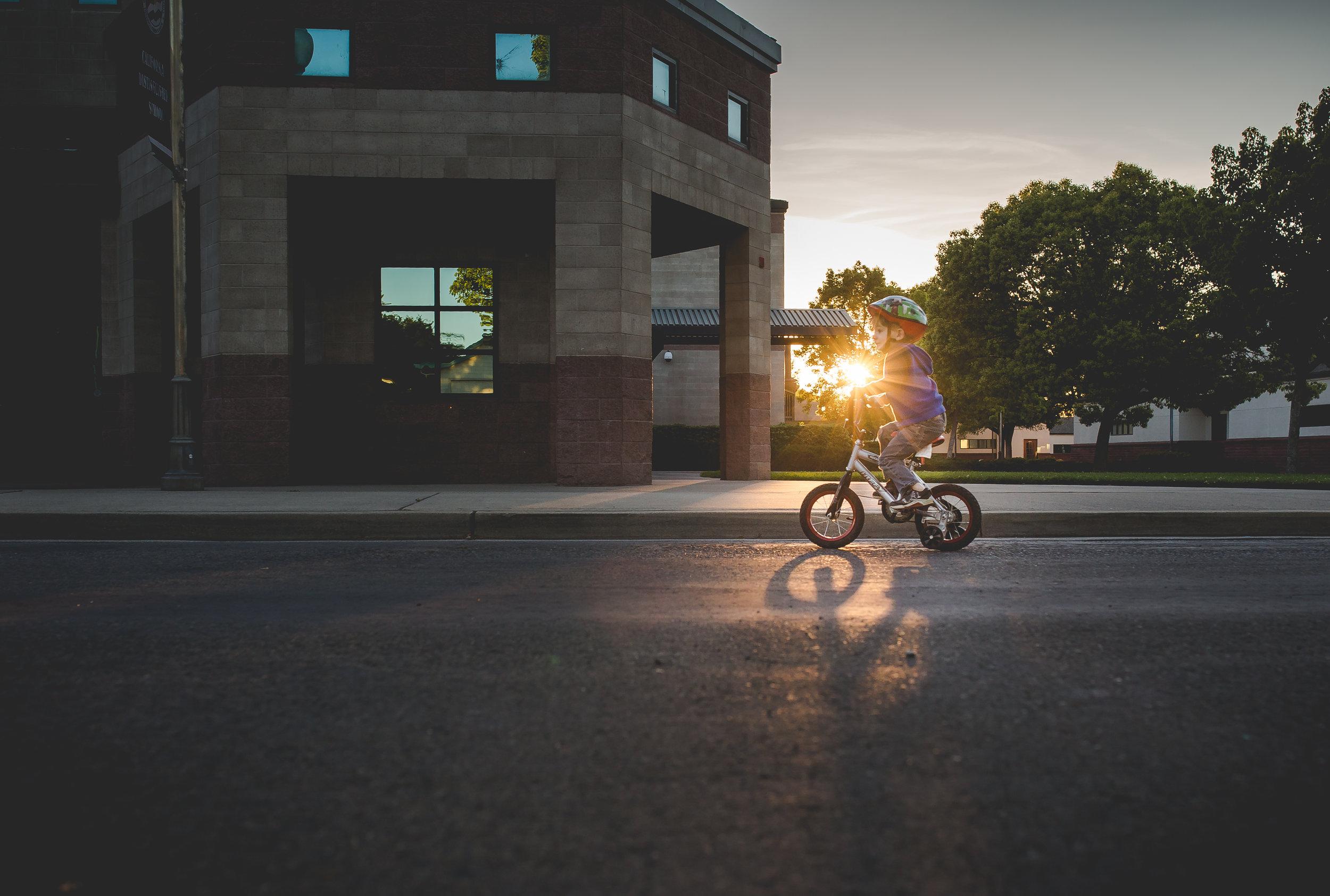 jesse on bike with sunburst 365.jpg