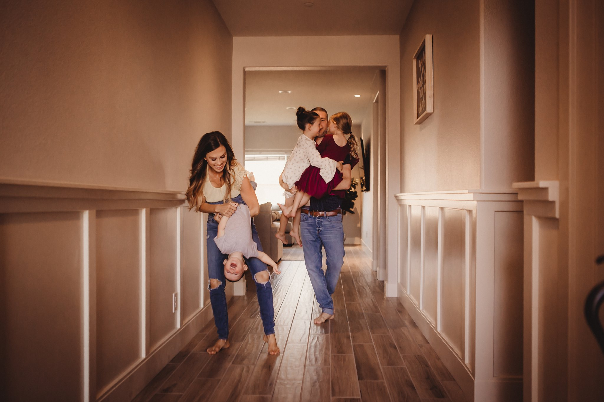 Family dancing in their hallway