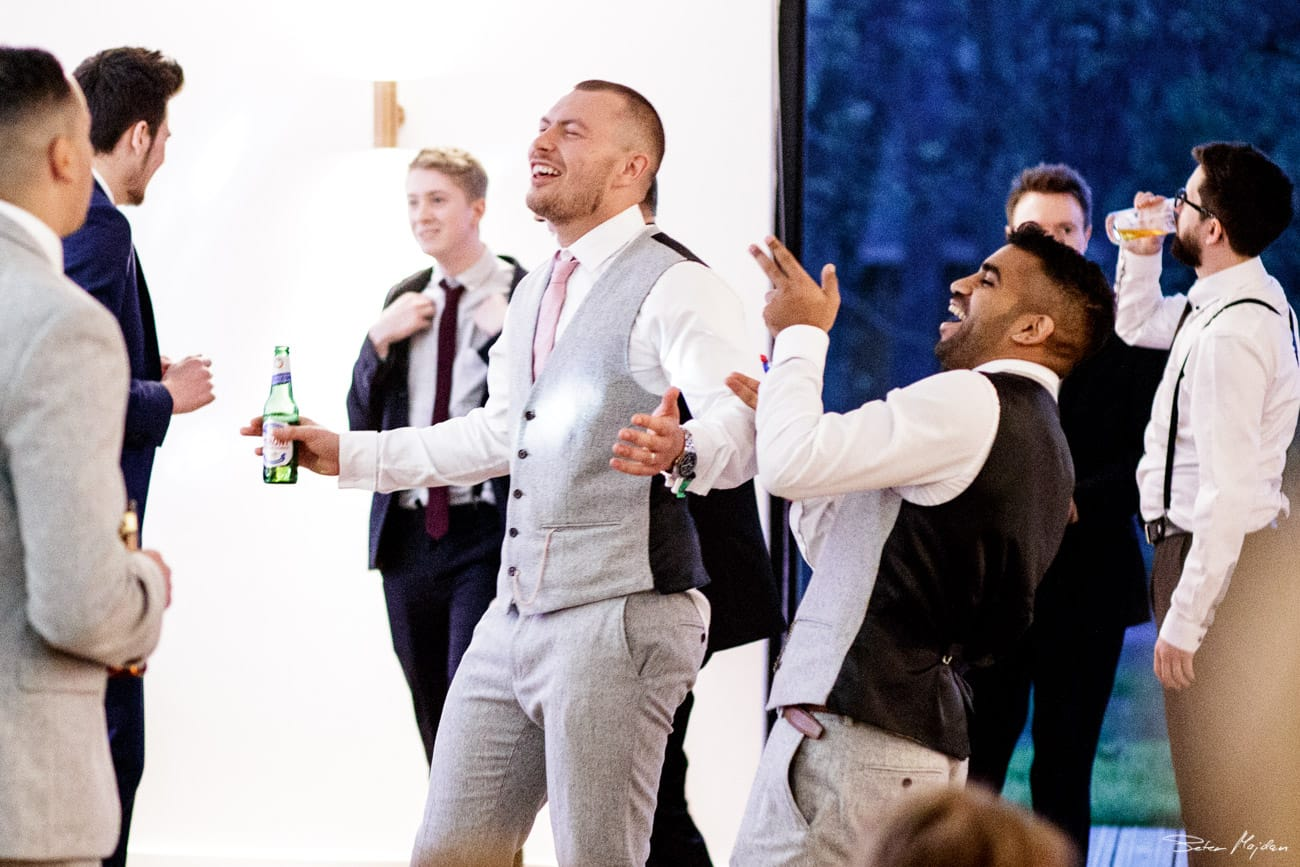 groom and groomsmen dancing